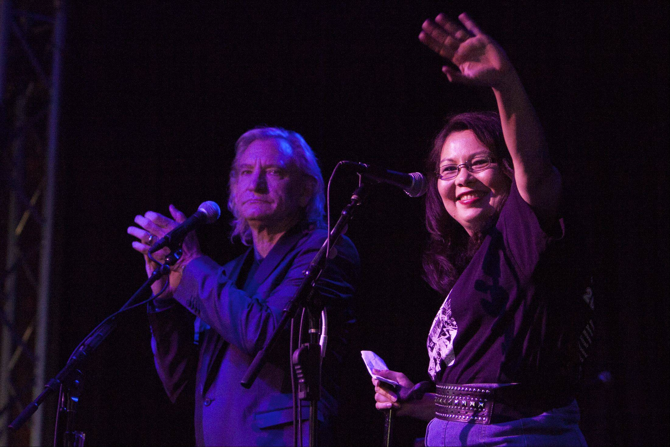 Joel Bissell/jbissell@dailyherald.comTammy Duckworth waves to her 500 volunteers/supporters before Joe Walsh took the stage with his guitar.