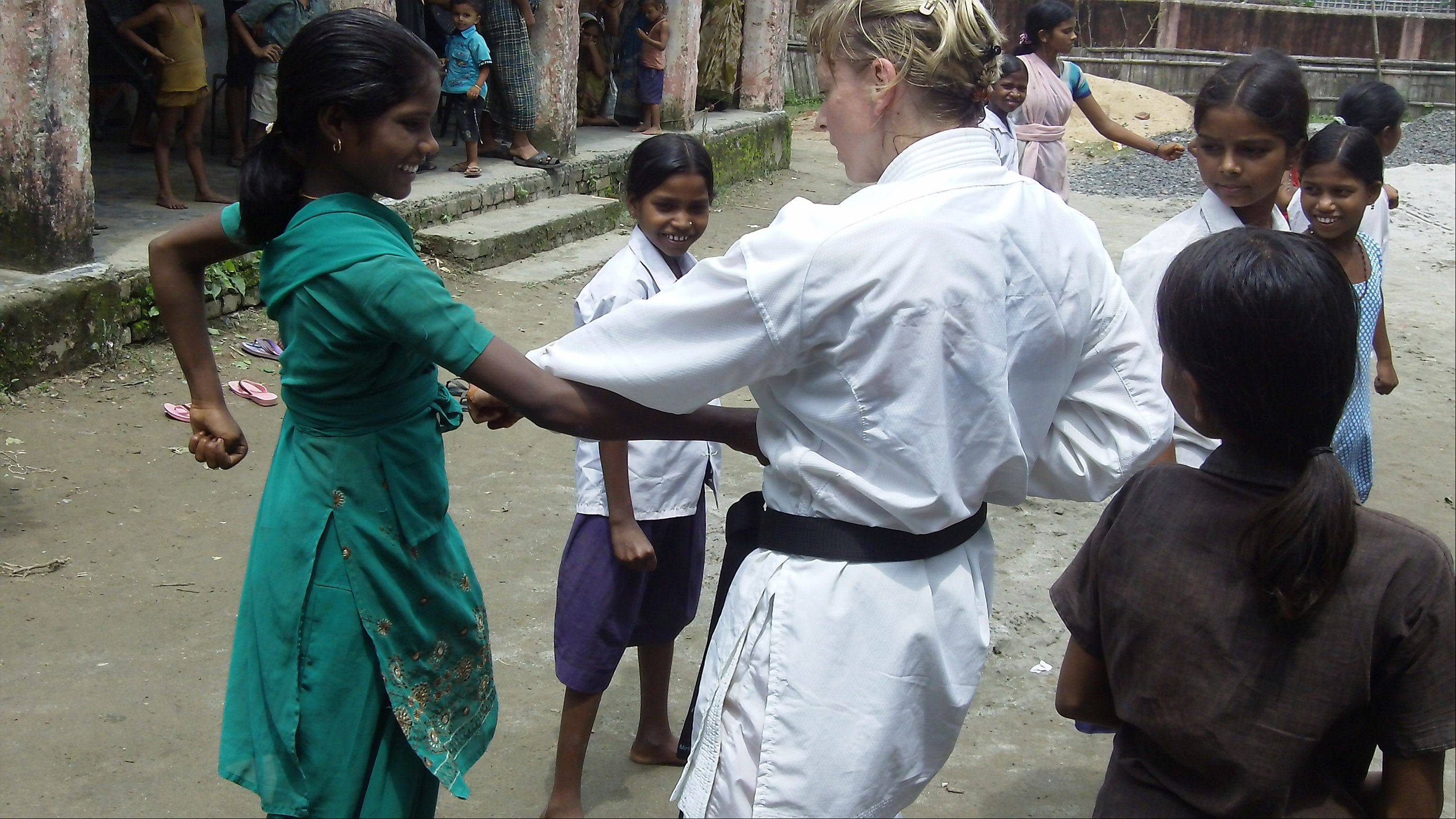 Belle Staurowsky teaches self-defense classes for girls who have been victims of -- or are at risk for -- sex trafficking through Green Tara Project, the nonprofit she founded in 2010. Here she is pictured in Babuan, in the Indian state of Bihar.