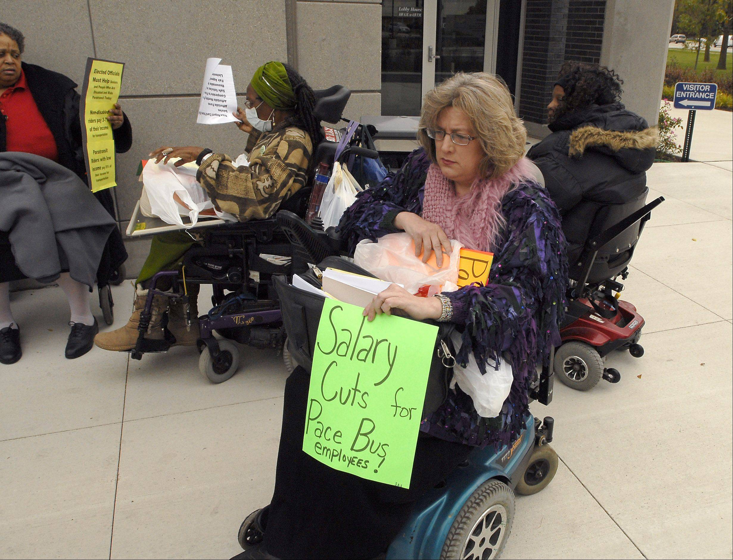Riders with disabilities protest proposed fare hikes at Pace headquarters in Arlington Heights in 2009.