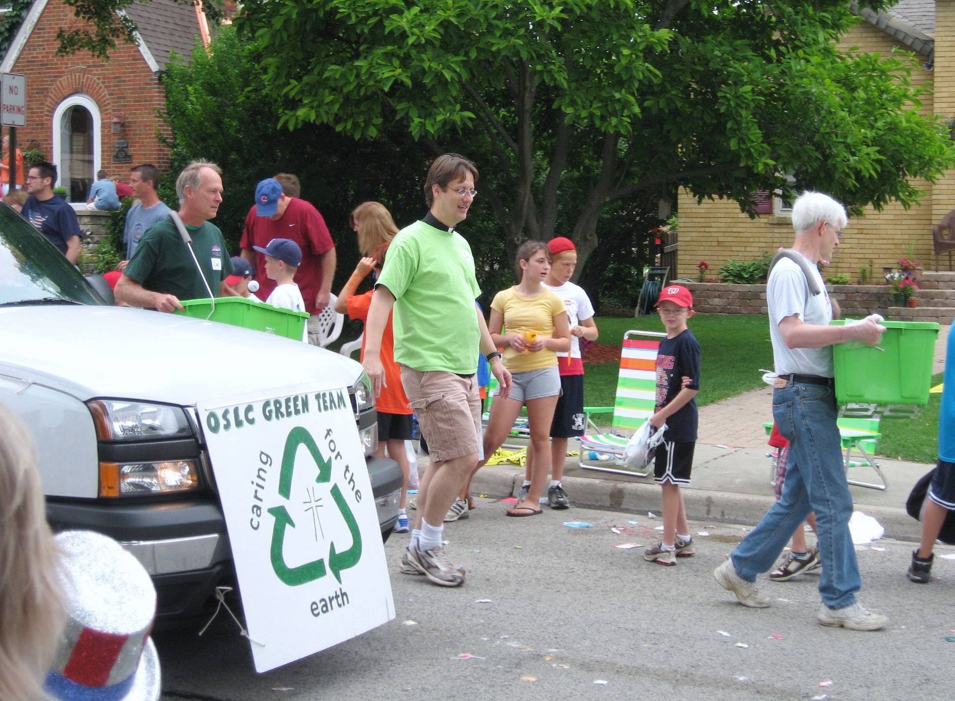 Marching Our Saviour's Lutheran members recycle after the July 4 parade.