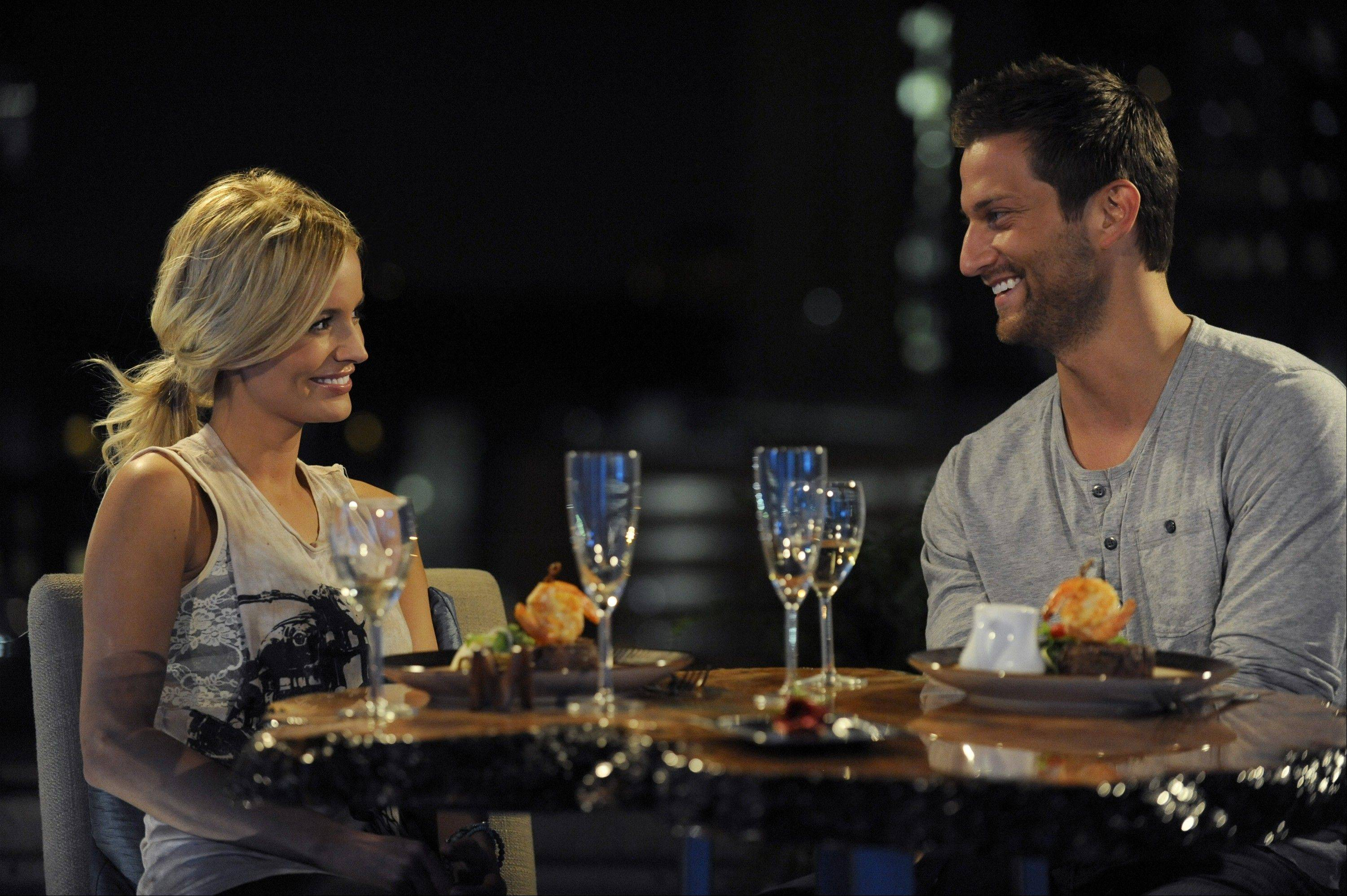 "Chris Bukowski of Bartlett and ""Bachelorette"" star Emily Maynard enjoy a dinner earlier this season in her hometown, Charlotte, N.C."