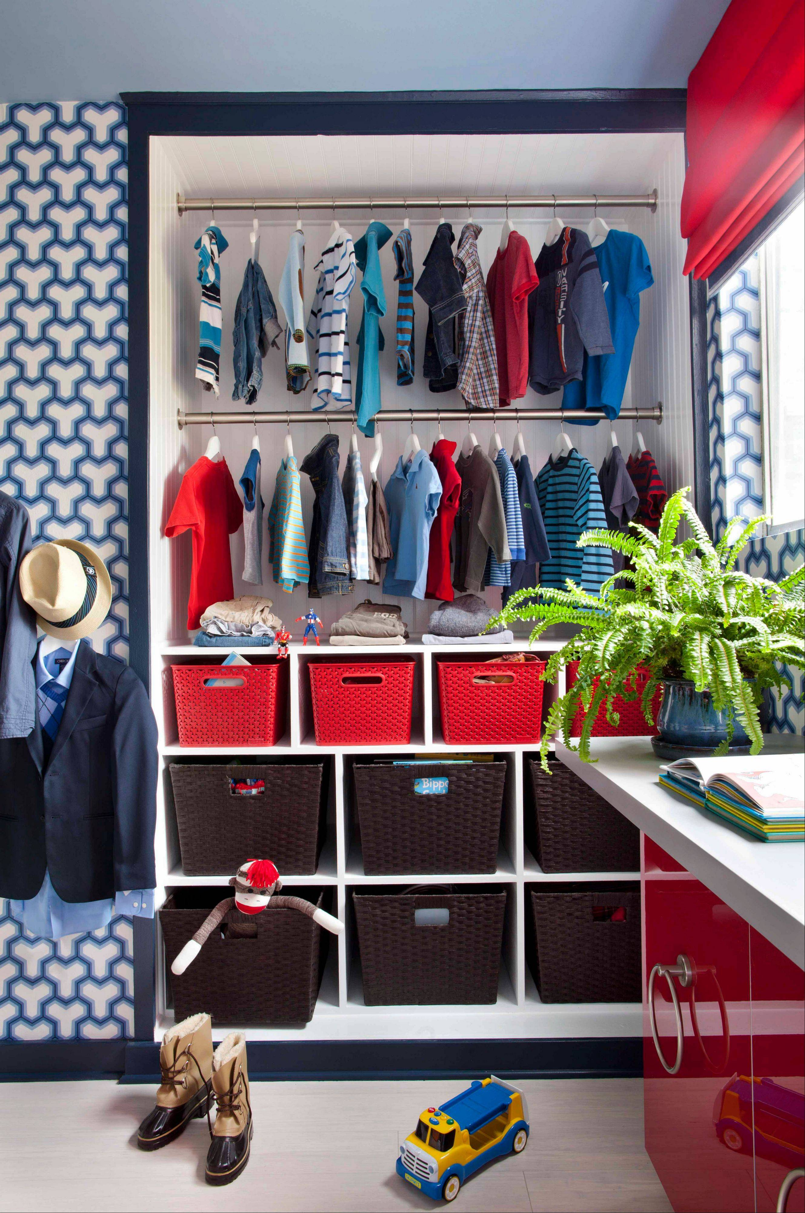 Designer Brian Patrick Flynn used red, white, and blue, in a modern manner for a boy?s room with graphic wallpaper in blue and white, accented with controlled bursts of fire engine red.