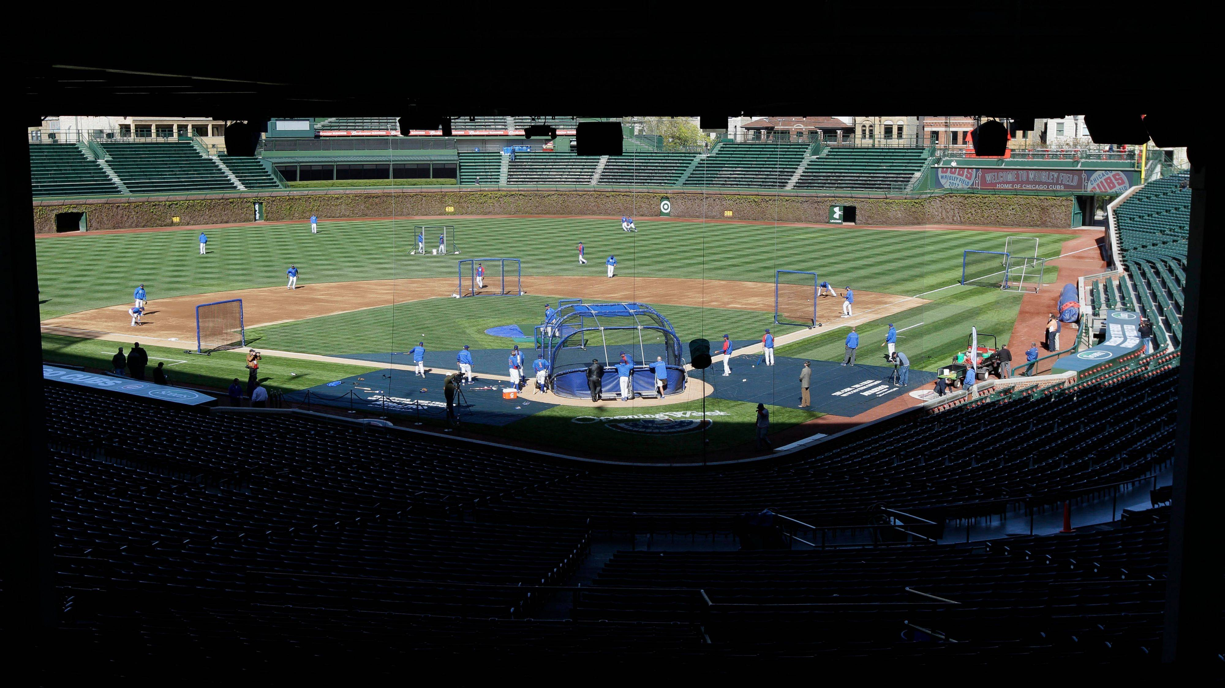 Cubs players work out at Wrigley Field the day before their season opener against the Washington Nationals.