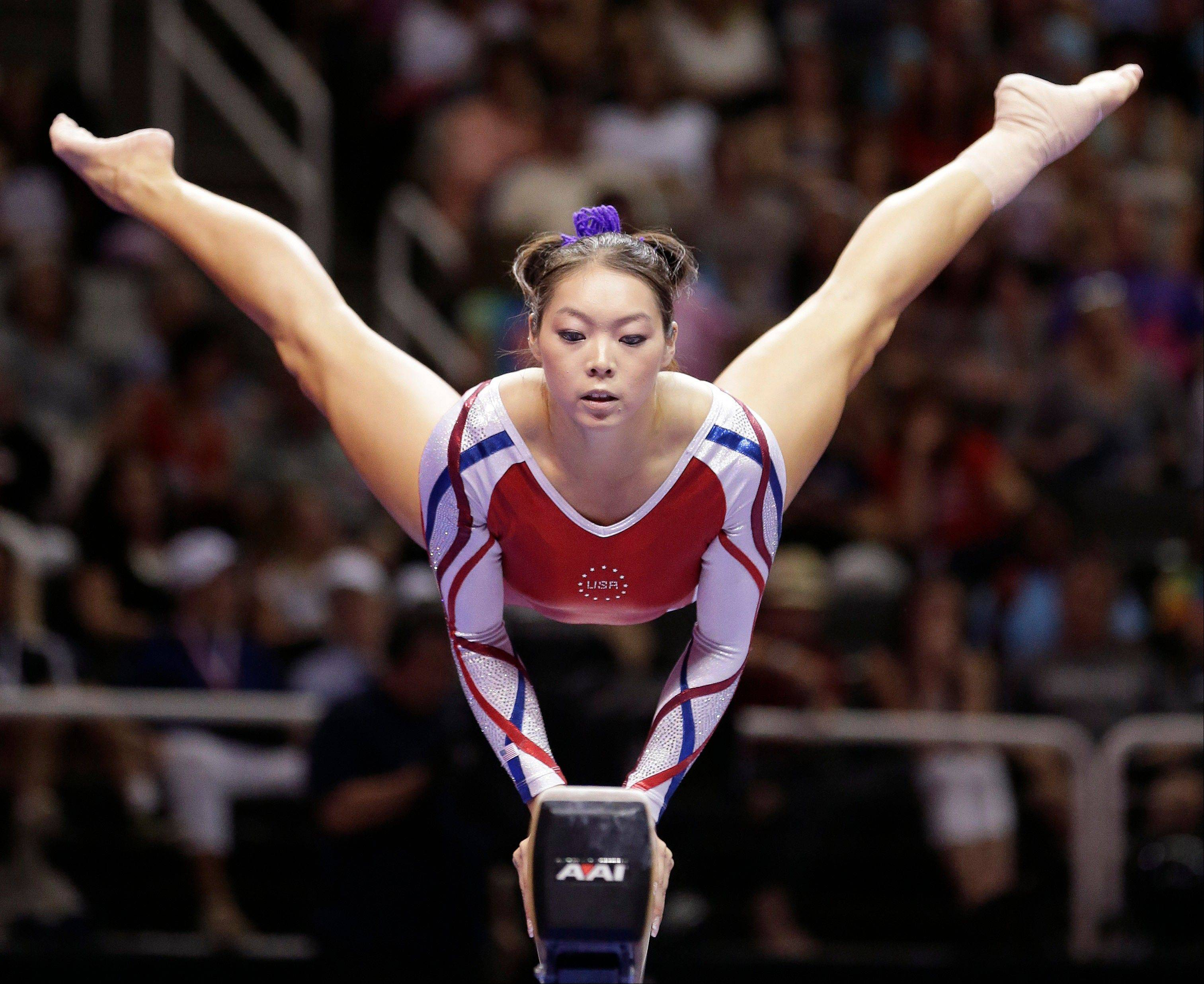 Anna Li performs on the balance beam Sunday during the final round of the women�s Olympic gymnastics trials in San Jose, Calif. Li was named to the U.S. Olympic gymnastics team as one of three alternates and will be going with the team to London.