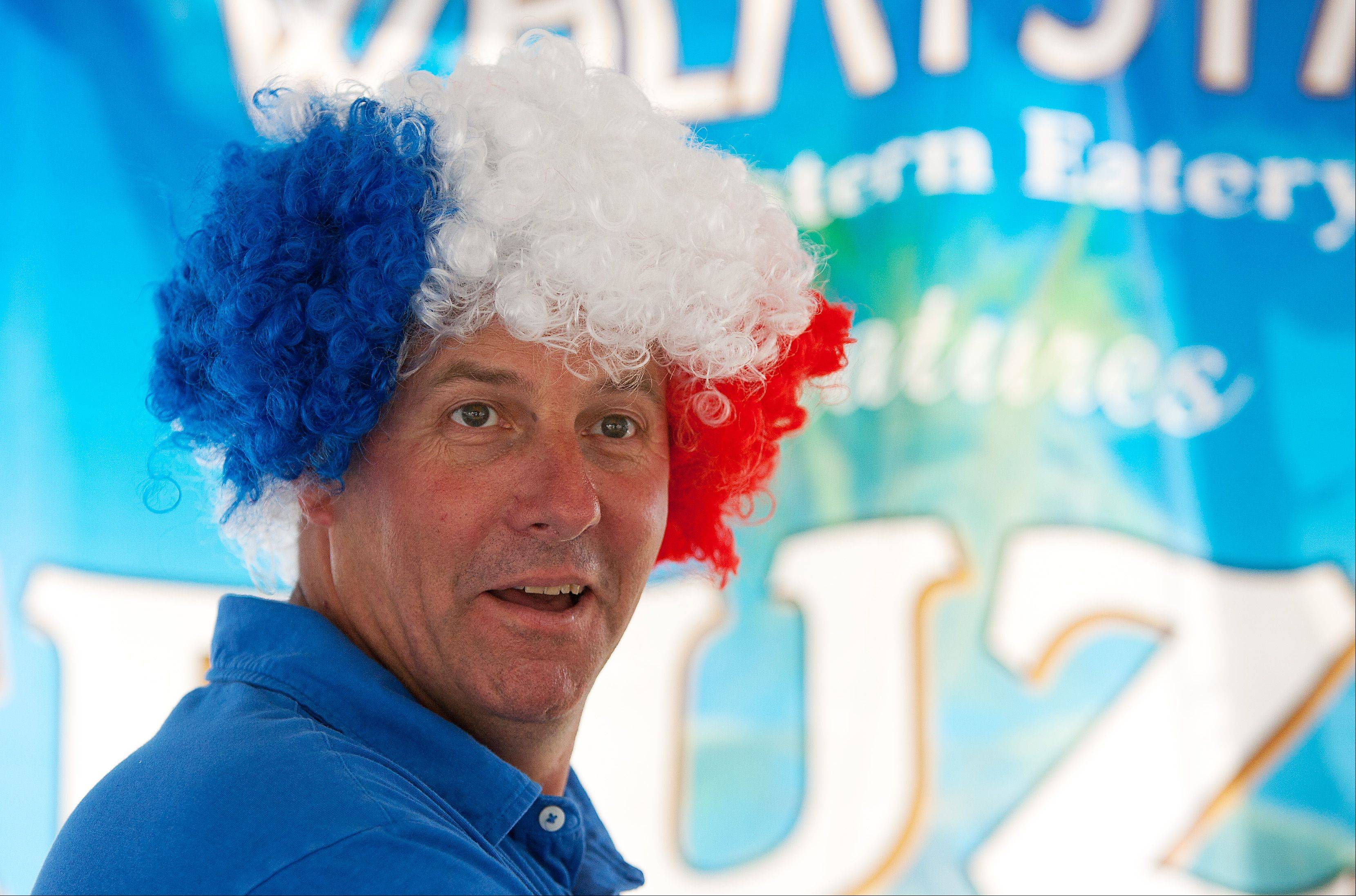Gregg Ireland brings his patriotic hair humor to the Wheatstack Restaurant booth at the Eyes to the Skies Festival in Lisle.