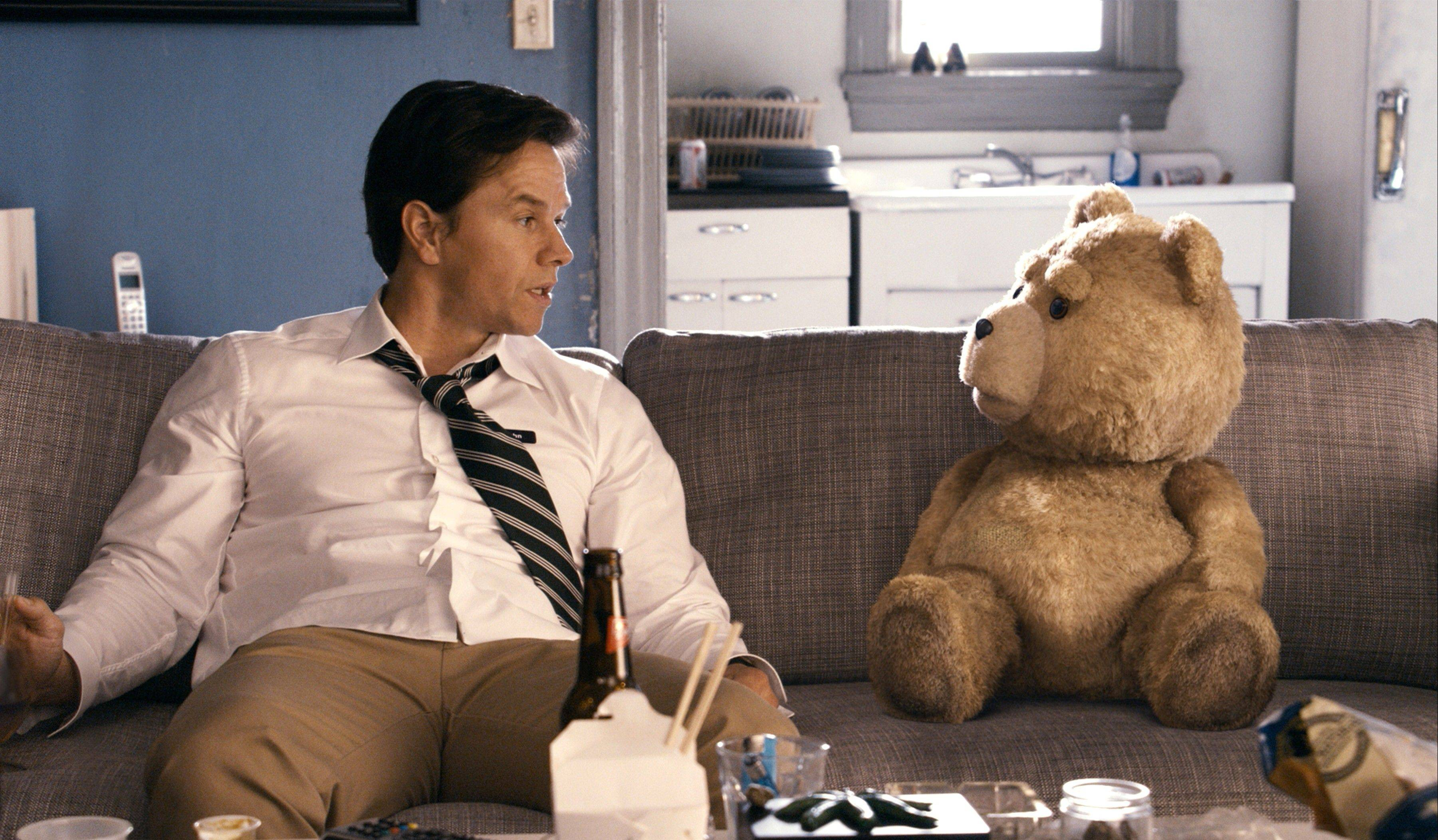 "Mark Wahlberg with the character Ted, voiced by Seth MacFarlane in a scene from ""Ted,"" which dominated the box office with a $54.1 million haul."