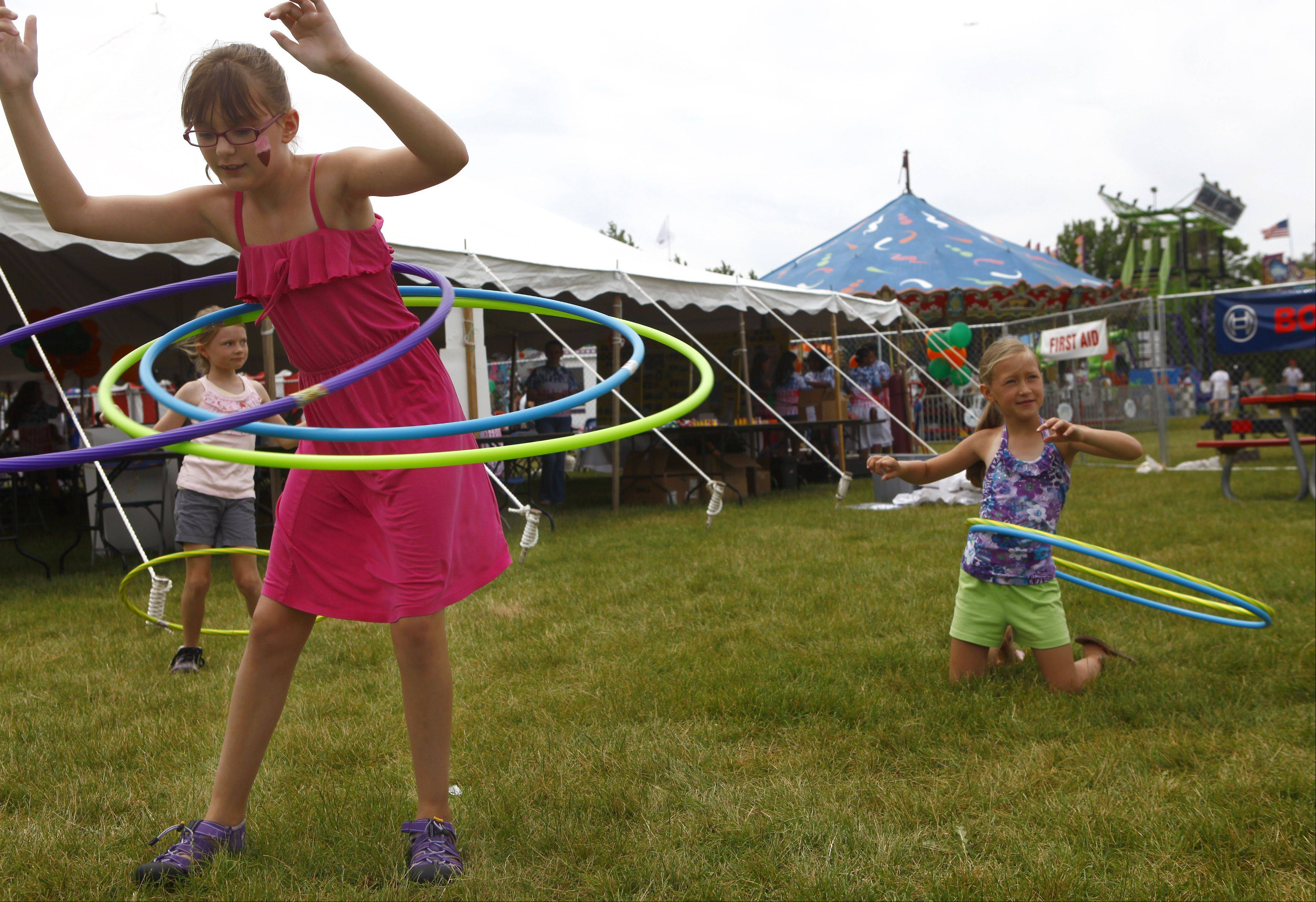 Samantha Goc, left, from Gilberts, practices with three hoola-hoops along with Julia Jacob from Mount Prospect during last year's festival.