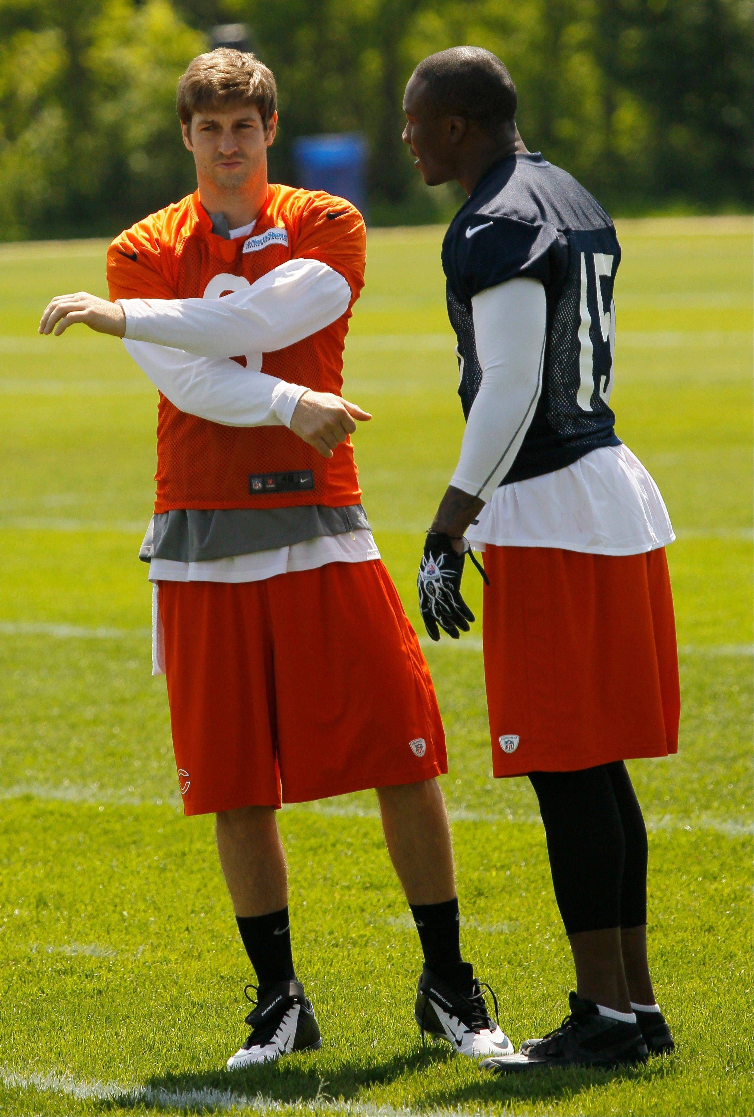 It�s a vastly improved offense now for Bears quarterback Jay Cutler, left, with the addition of wide receiver Brandon Marshall. But some of the preseason expectations for the team might be a bit over the top.