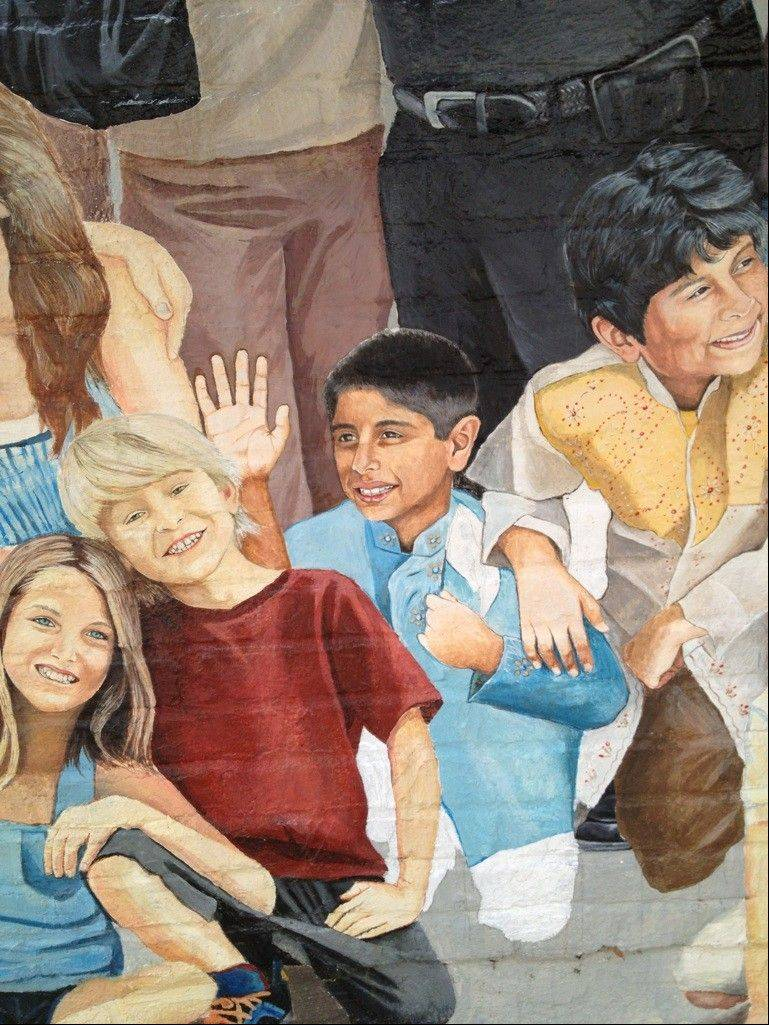 The Naperville wall mural that includes Jai Shekhawat's son, Gaurav.