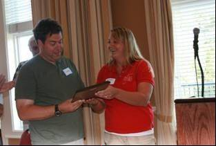 Image courtesy of DuPage Special Recreation Association Greg Bizarro receiving the Charlie Long Award from Western DuPage Special Recreation Association staff member Jorie Meyer.