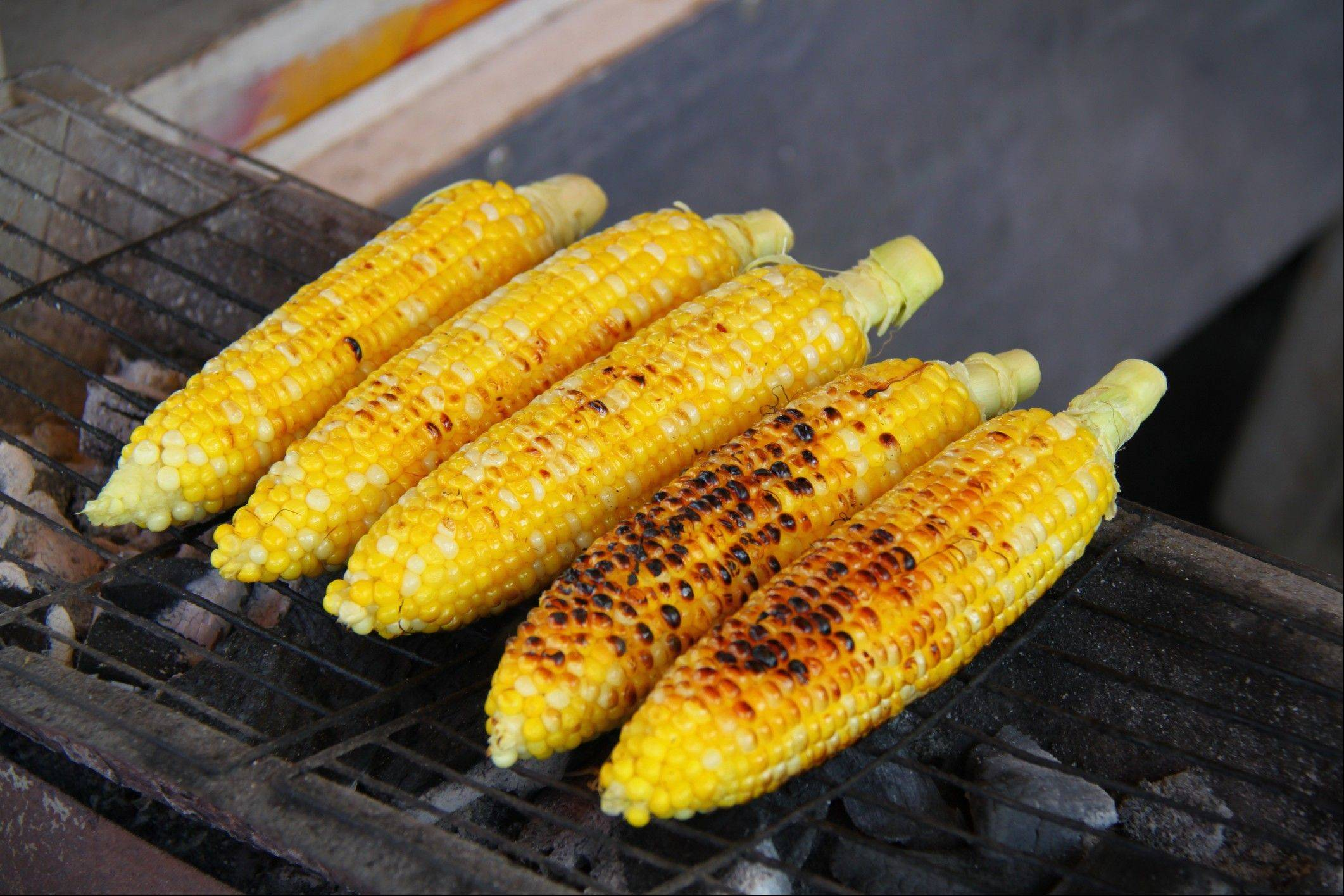 Corn on the cob takes about 10 minutes to cook over a medium-hot charcoal grill.