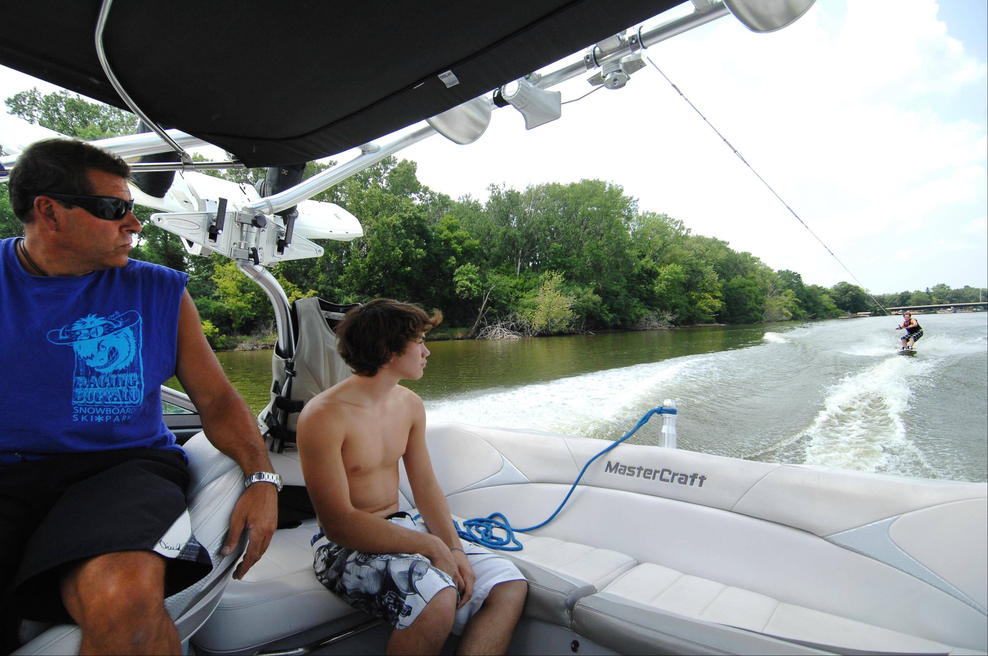 Xavier Contreras, 17, of Port Barrington, and driver Keith Duck watch as Devin Patterson, 13, of West Dundee, takes a wakeboard lesson on the Fox River in Cary Monday.