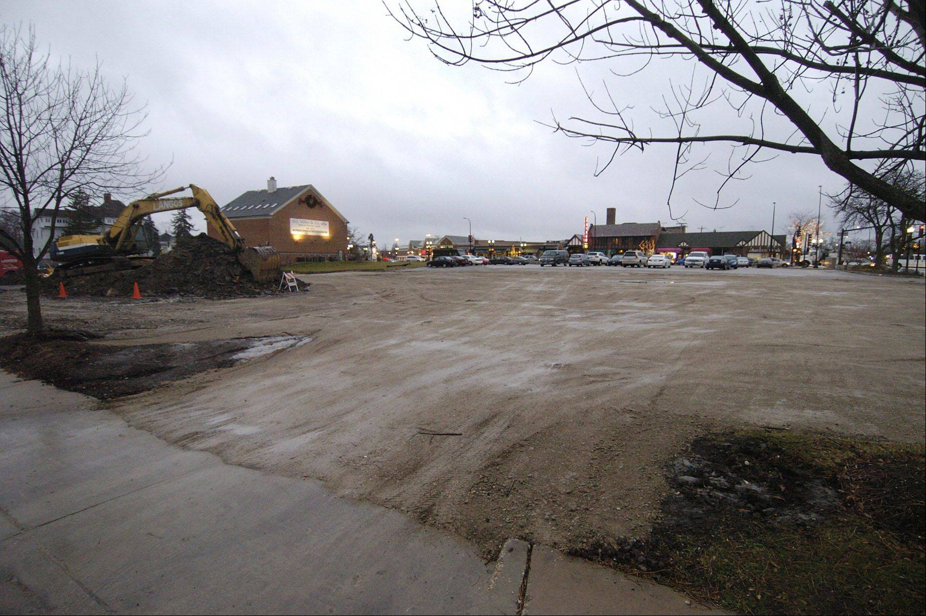 Before new stores can be built on this vacant site in downtown Barrington, the village must complete the replacement of its 114-year-old water main underneath Lake-Cook Road, in the background of this photo.