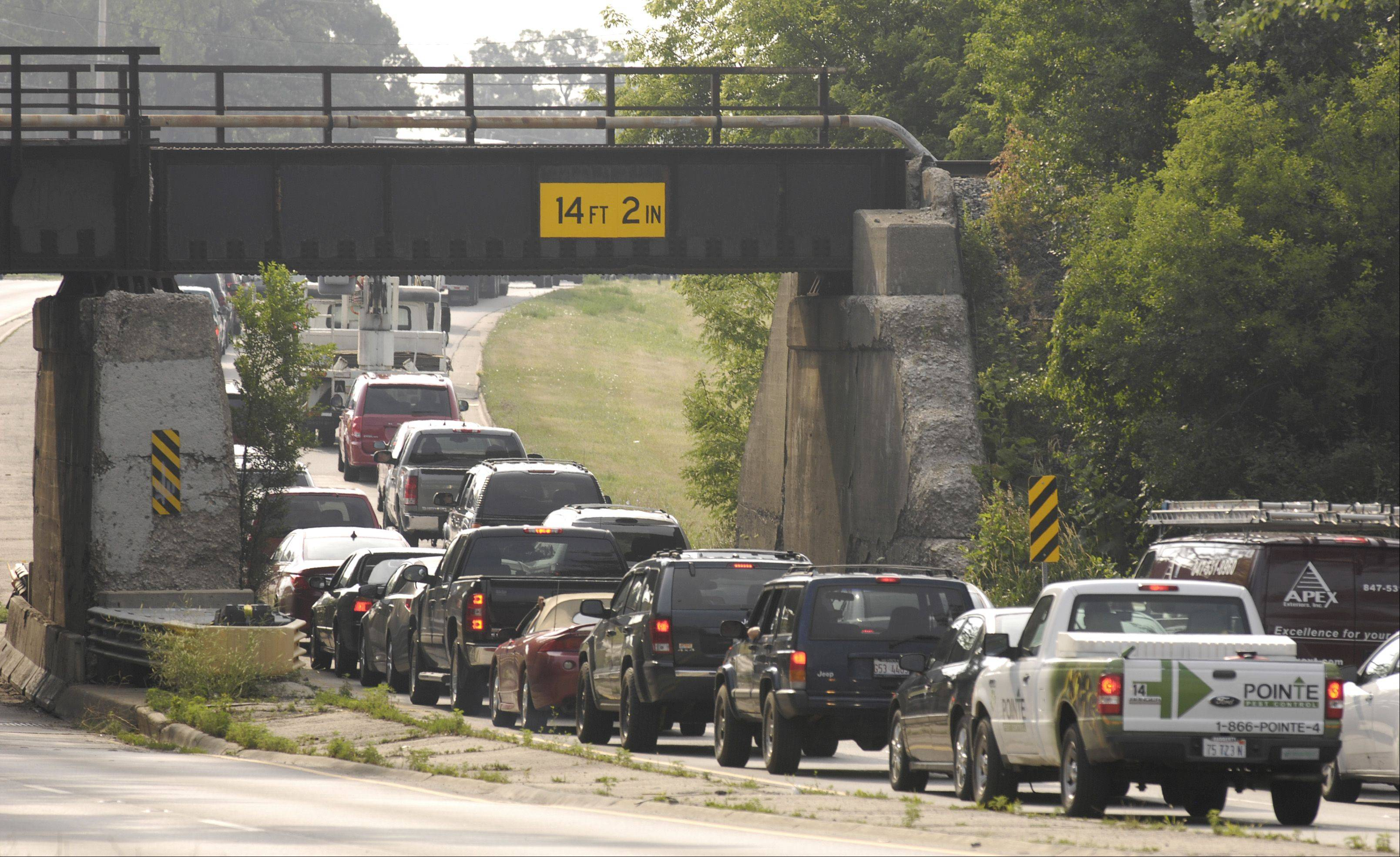 Roosevelt Road in West Chicago is backed up Monday due to power outages in the area that put the traffic light at Joliet Street out of service. The Sunday afternoon storm that rolled through DuPage County downed trees, chimneys and cut power to tens of thousands in the Chicago area.