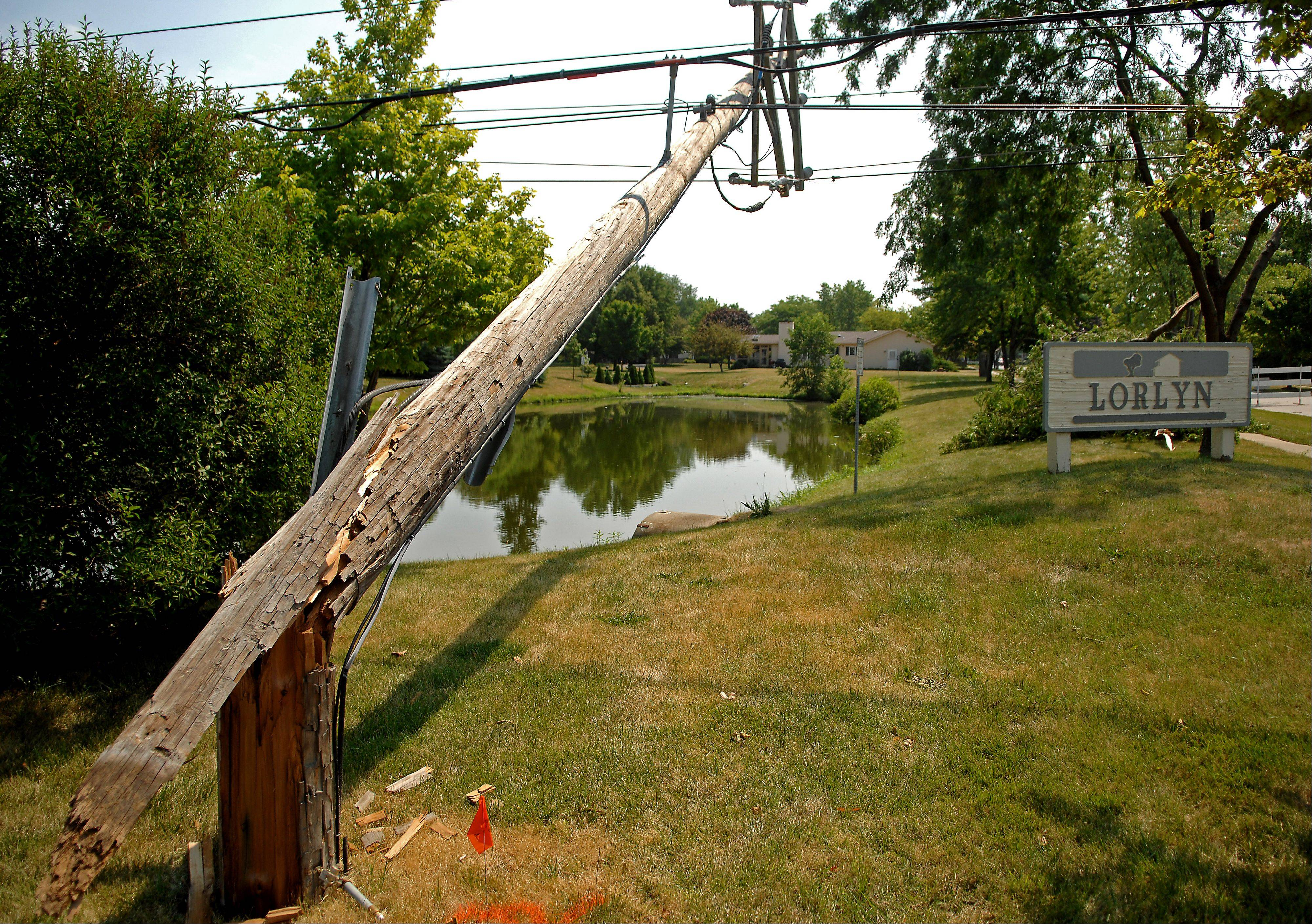 A utility pole lies broken on Western Avenue just north of Navajo Drive in Batavia Monday after a short but powerful storm did considerable damage in the Tri-Cities Sunday. It was one of about six poles in a row that were damaged or leaning on trees.
