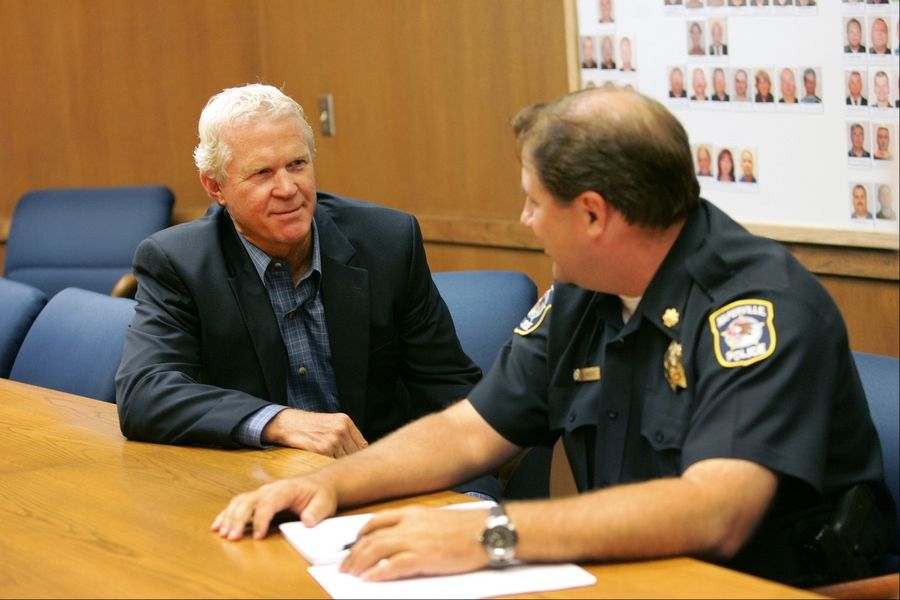 Police Chief Bob Marshall, left, chats with Cmdr. Mike Anders at the station in Naperville.