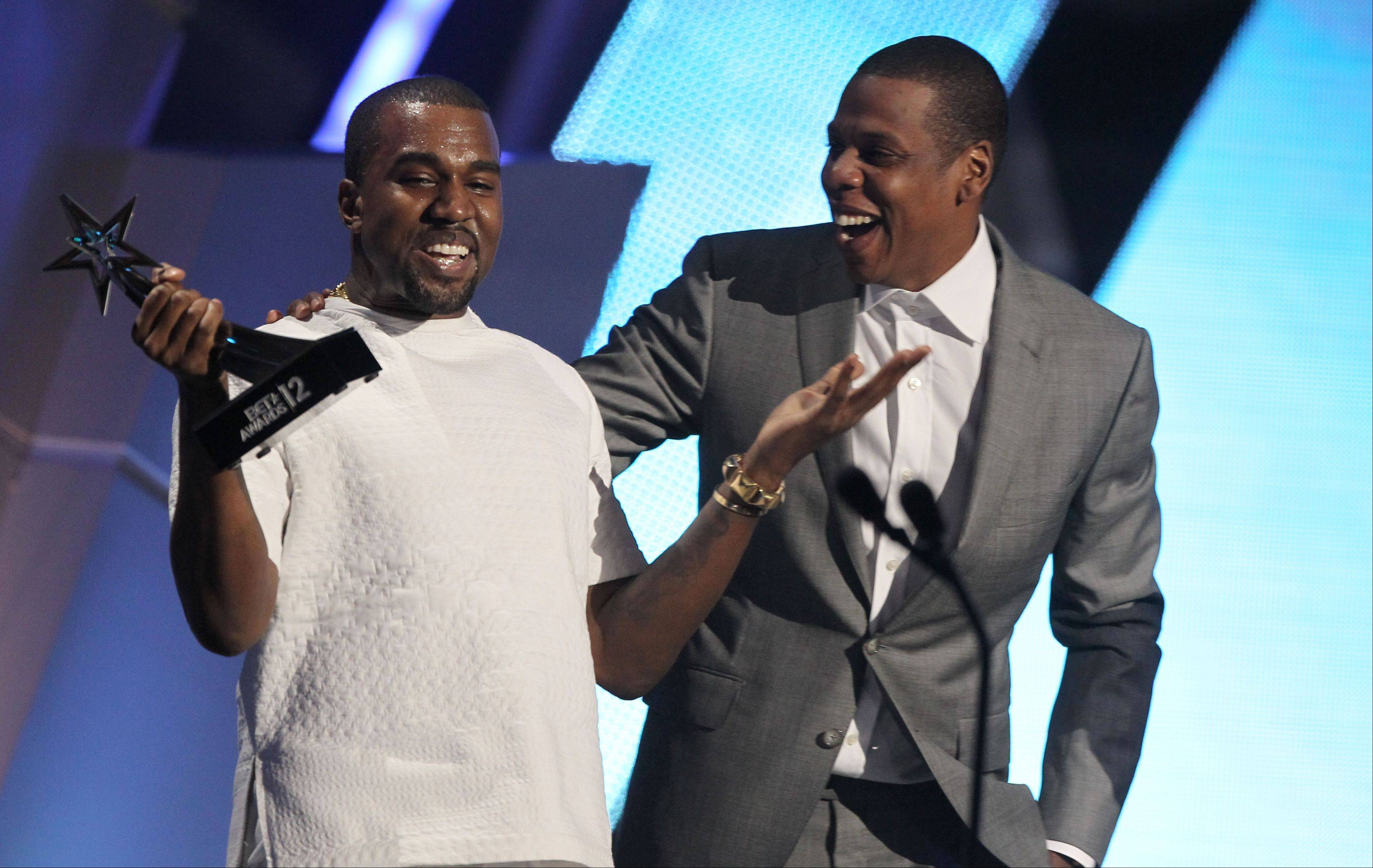 "Kanye West, left, and Jay-Z accept the award for best group for ""The Throne"" at the BET Awards on Sunday in Los Angeles."