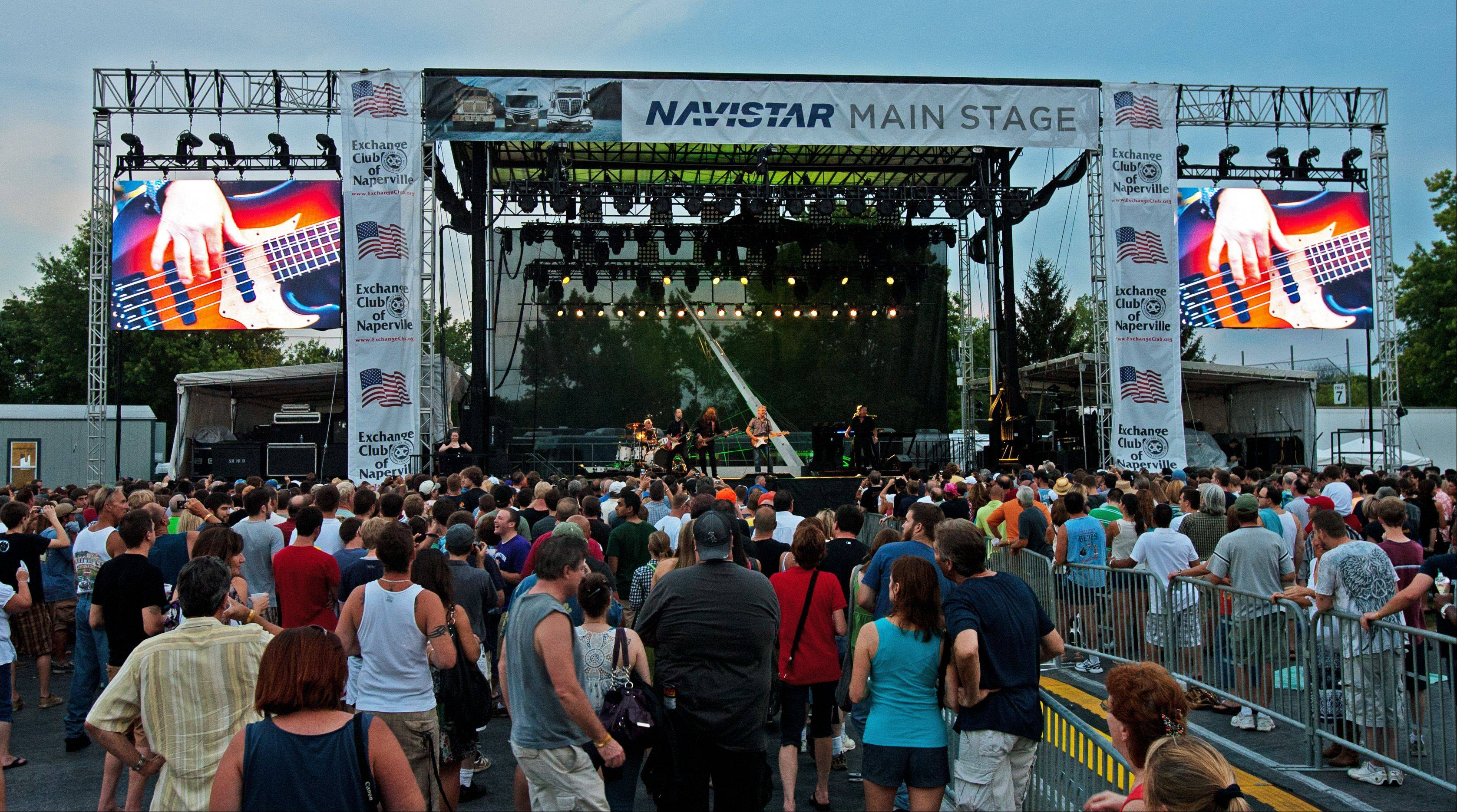 Thousands listen to the Steve Miller Band who headline the first day of Ribfest in Naperville.