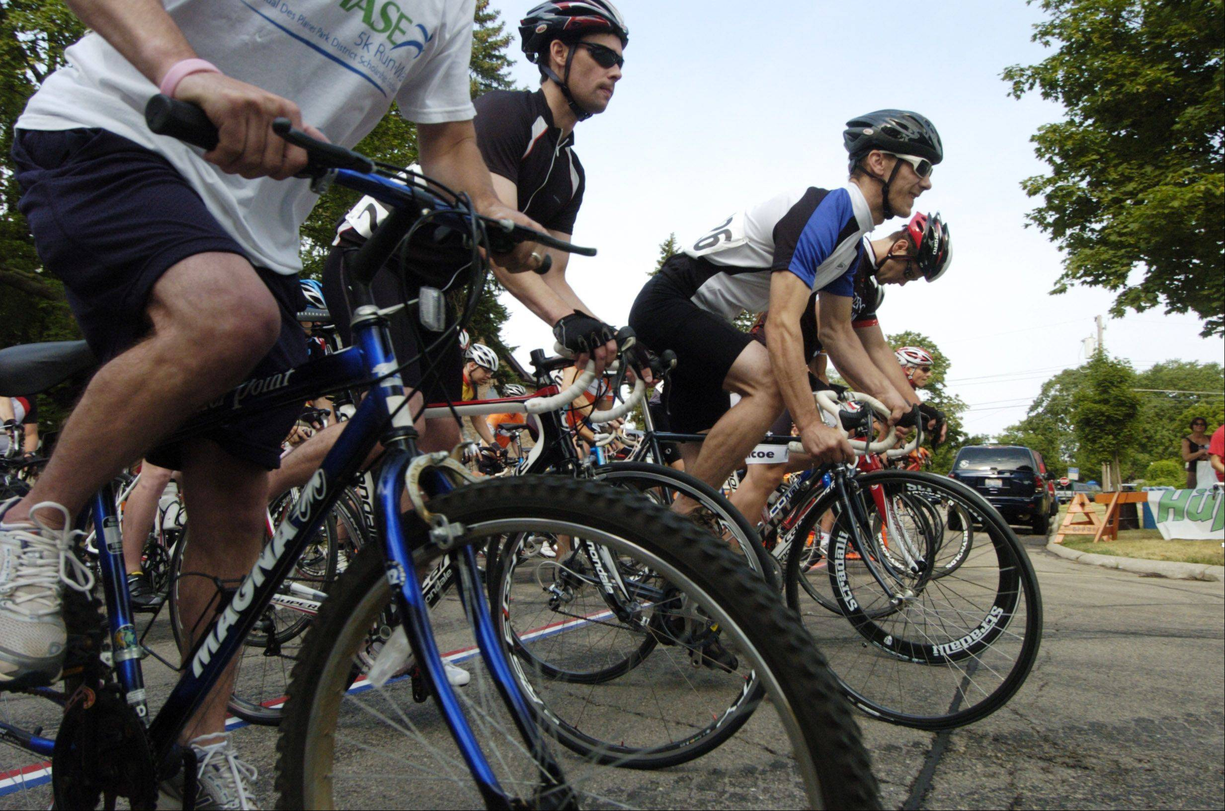"Riders in the second race leave the start line during the Tour ""De Villas"" bike race in Des Plaines Saturday."