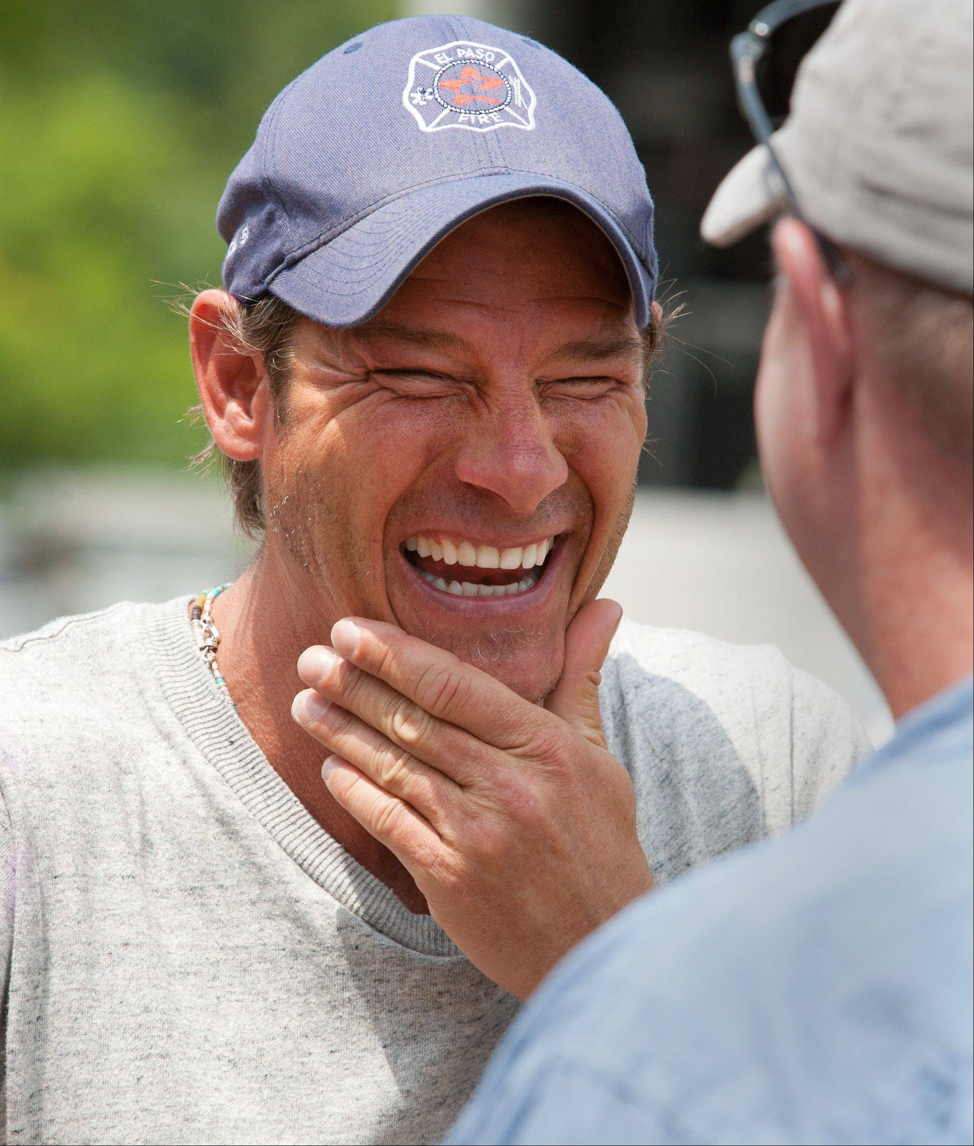 "TV personality Ty Pennington moves around Naperville's Ribfest as part of the ""Grilling is Happiness"" Sears team."