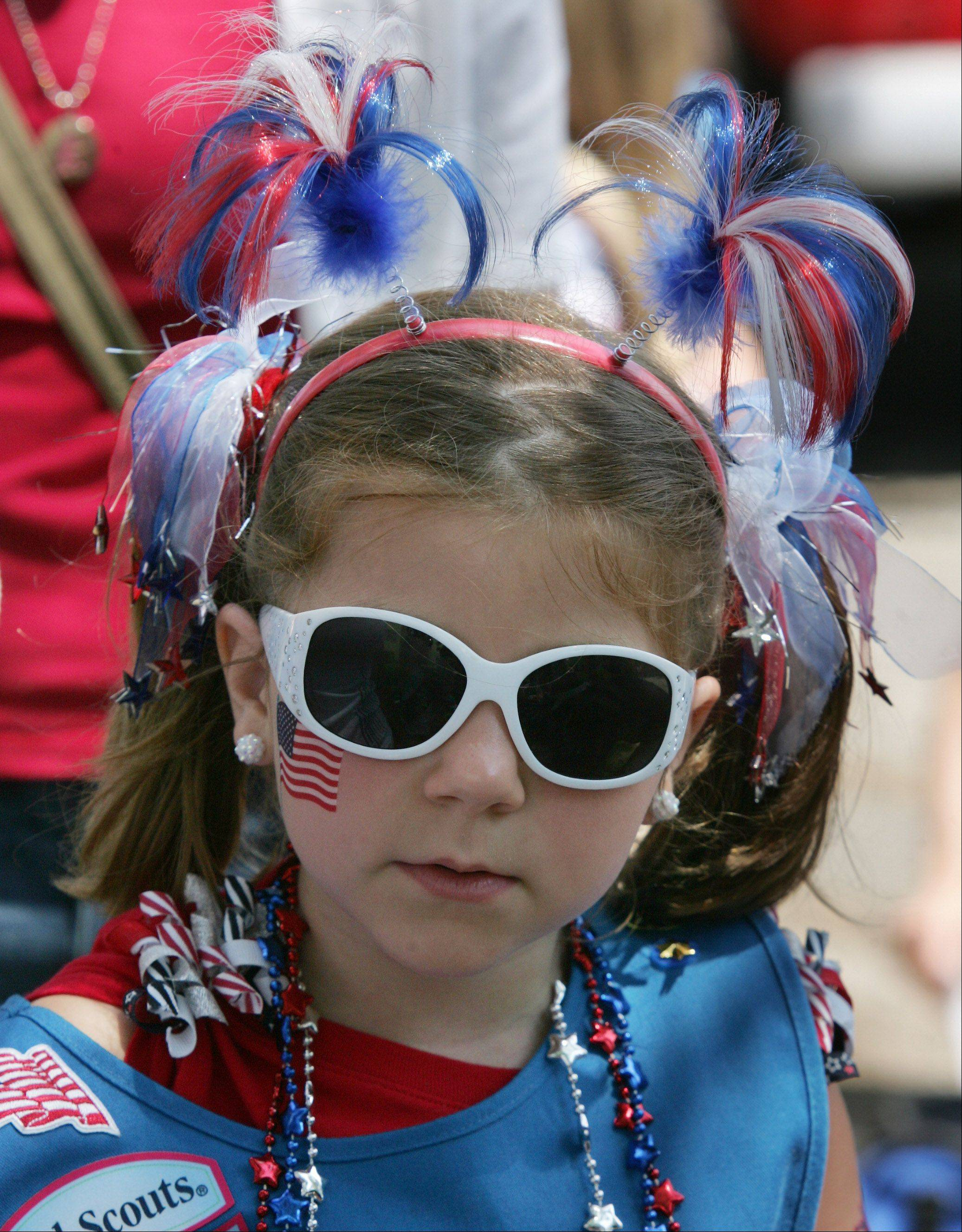 Girl Scout Kaelyn Pearson, 6, of Troop 40150 in Mundelein is decorated for the holiday during the Mundelein Community Days Parade Sunday as it makes its way along Hawley Street.