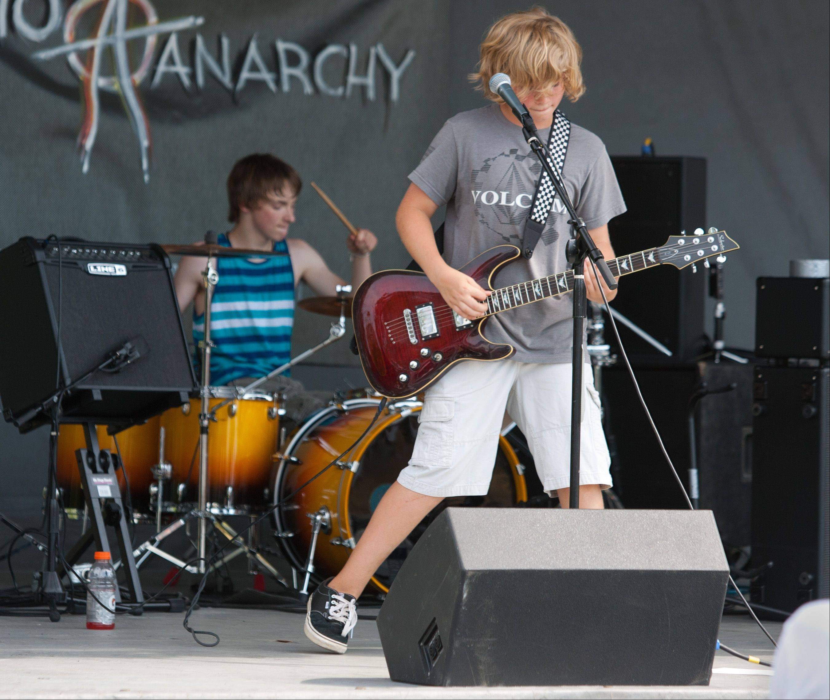 Audio Anarchy Band members Jeremy Whitmore of Elmhurst plays guitar while Tony Tedeschi of Wood Dale plays drums during the Eyes to the Skies Festival in Lisle.