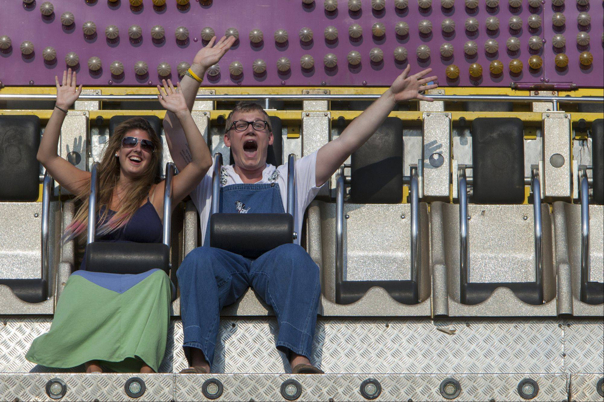 Nicollette Gramatis and Max Kornfeld, both of Libertyville, scream while on the ride, Ali Baba, at Mundelein Community Days.