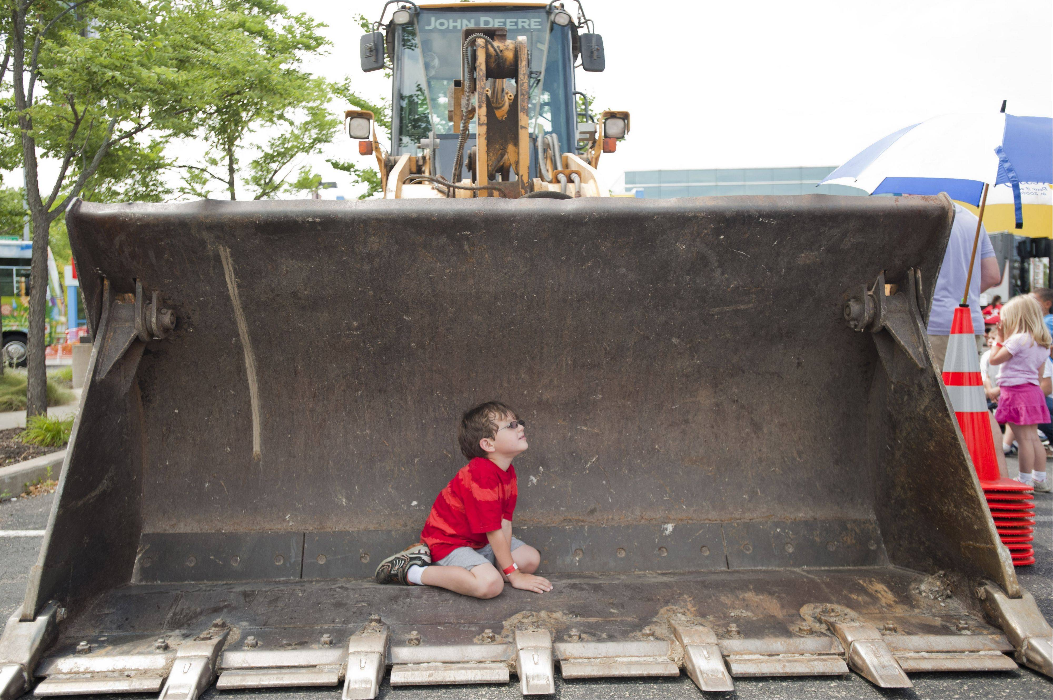 Malcolm Hoering, 6, gets a close look at various trucks while at the DuPage Children's Museum's 25th anniversary celebration on Sunday.