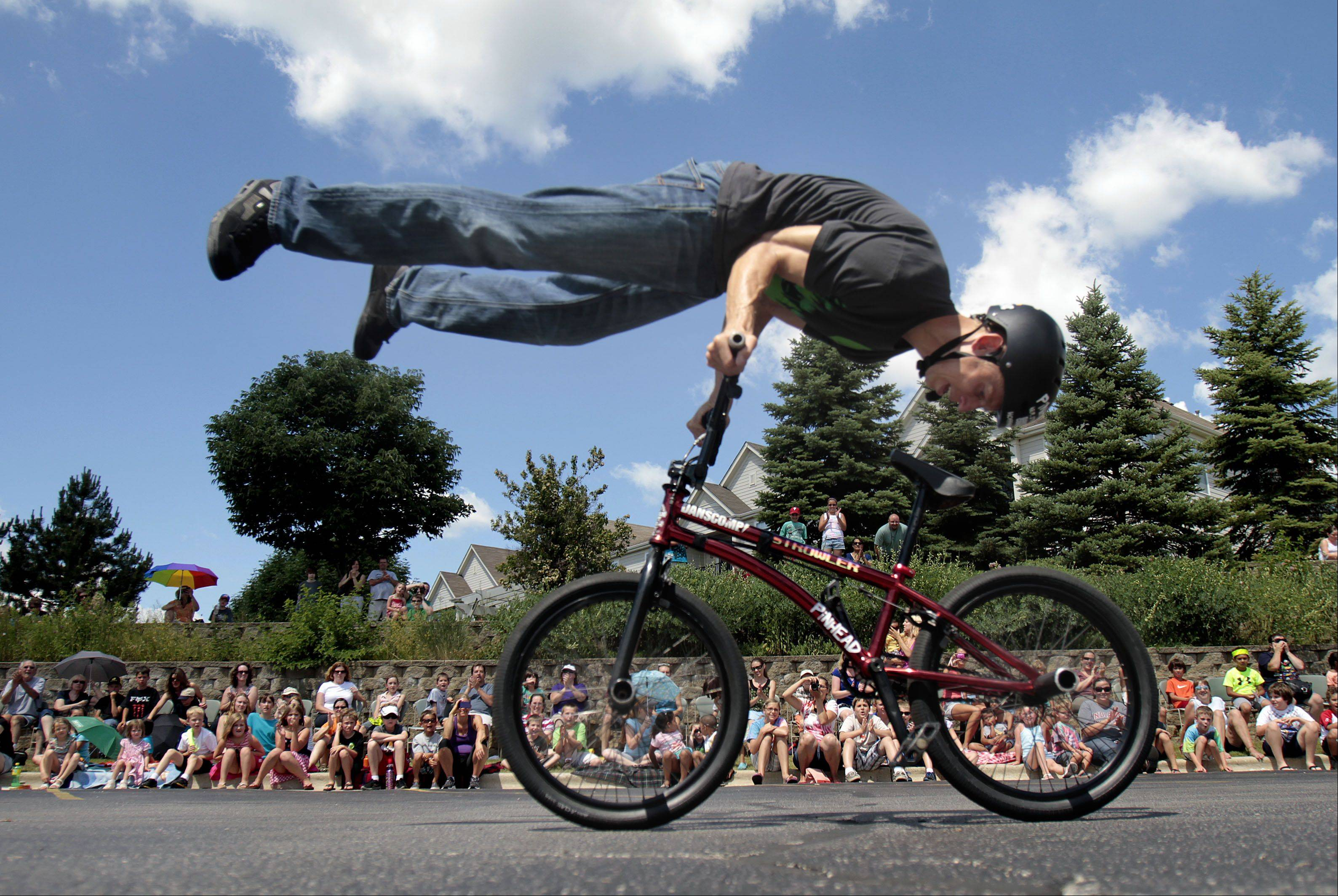 BMX champion Matt Wilhelm of Aurora amazes the audience with his bike tricks in the parking lot of Lake Villa District Public Library.