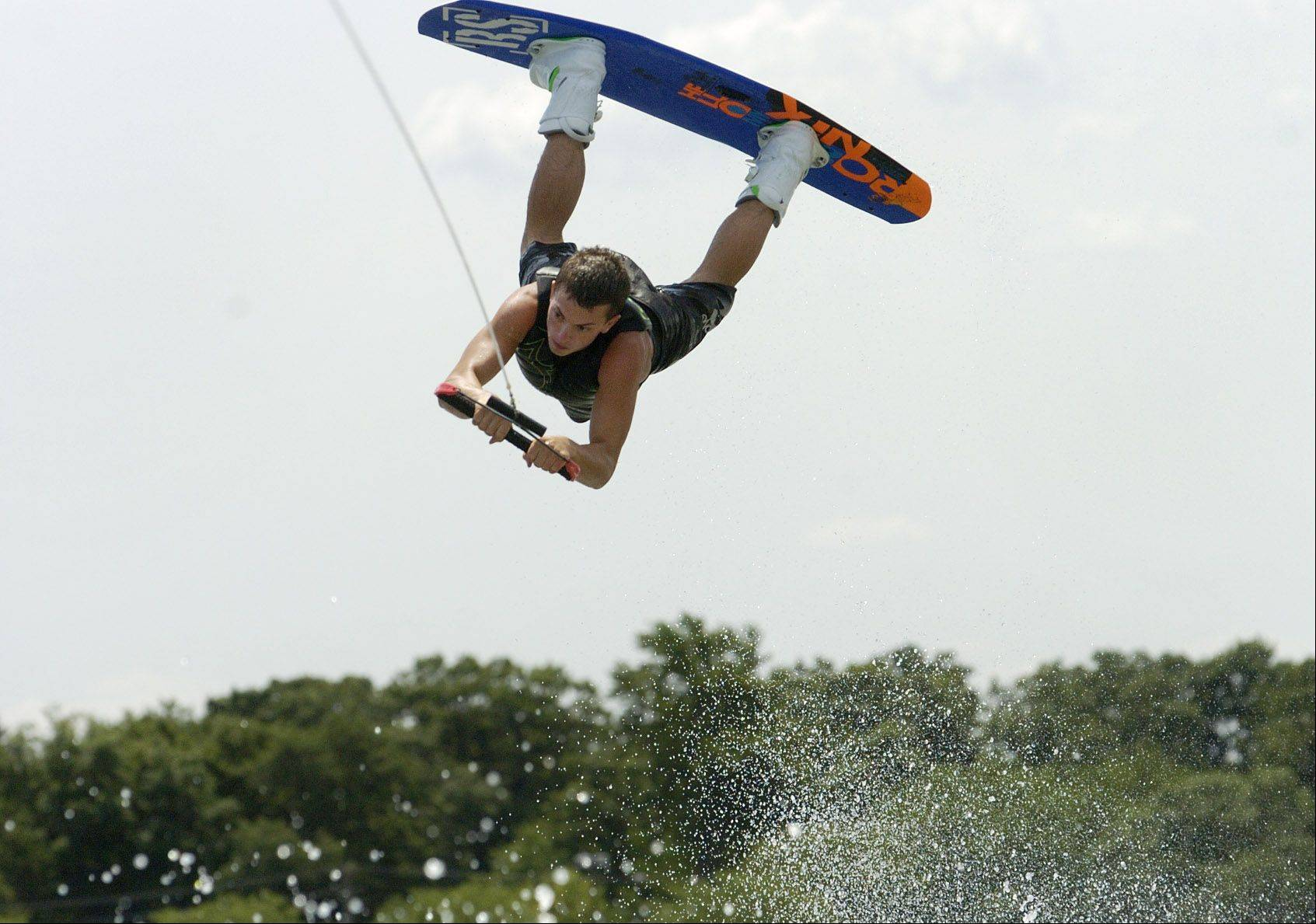 19-year-old Timmy Burnier of Sleepy Hollow, took 2nd place in the 2011 Nautique WWA Wakeboard National Championship in the Junior Men's Division. Here he puts on an exhibition at Mundelein Park District's Diamond Lake Wakeboard Spectacular.