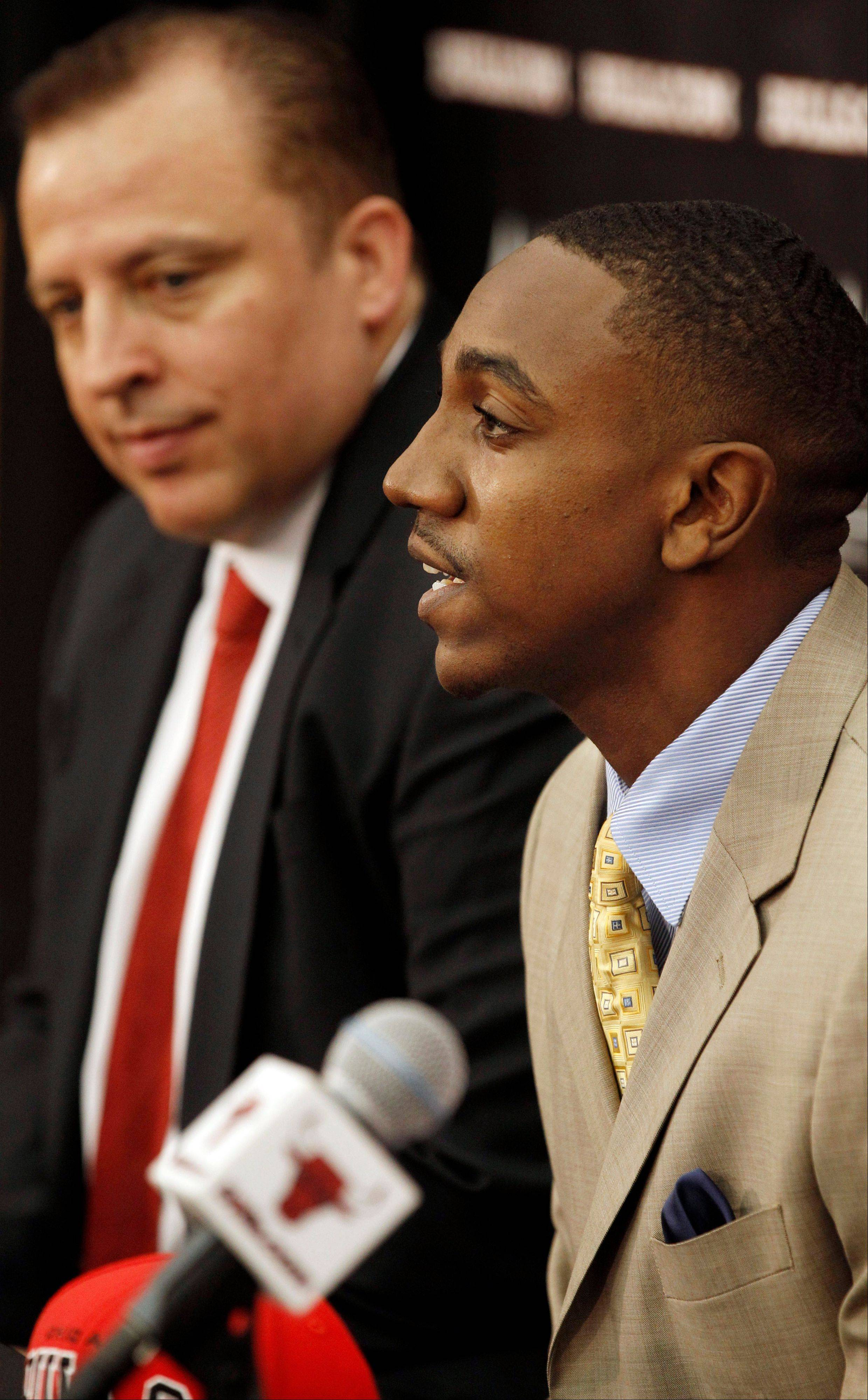 Marquis Teague, accompanied by Bulls coach Tom Thibodeau, addresses the media Monday during a news conference in Deerfield.
