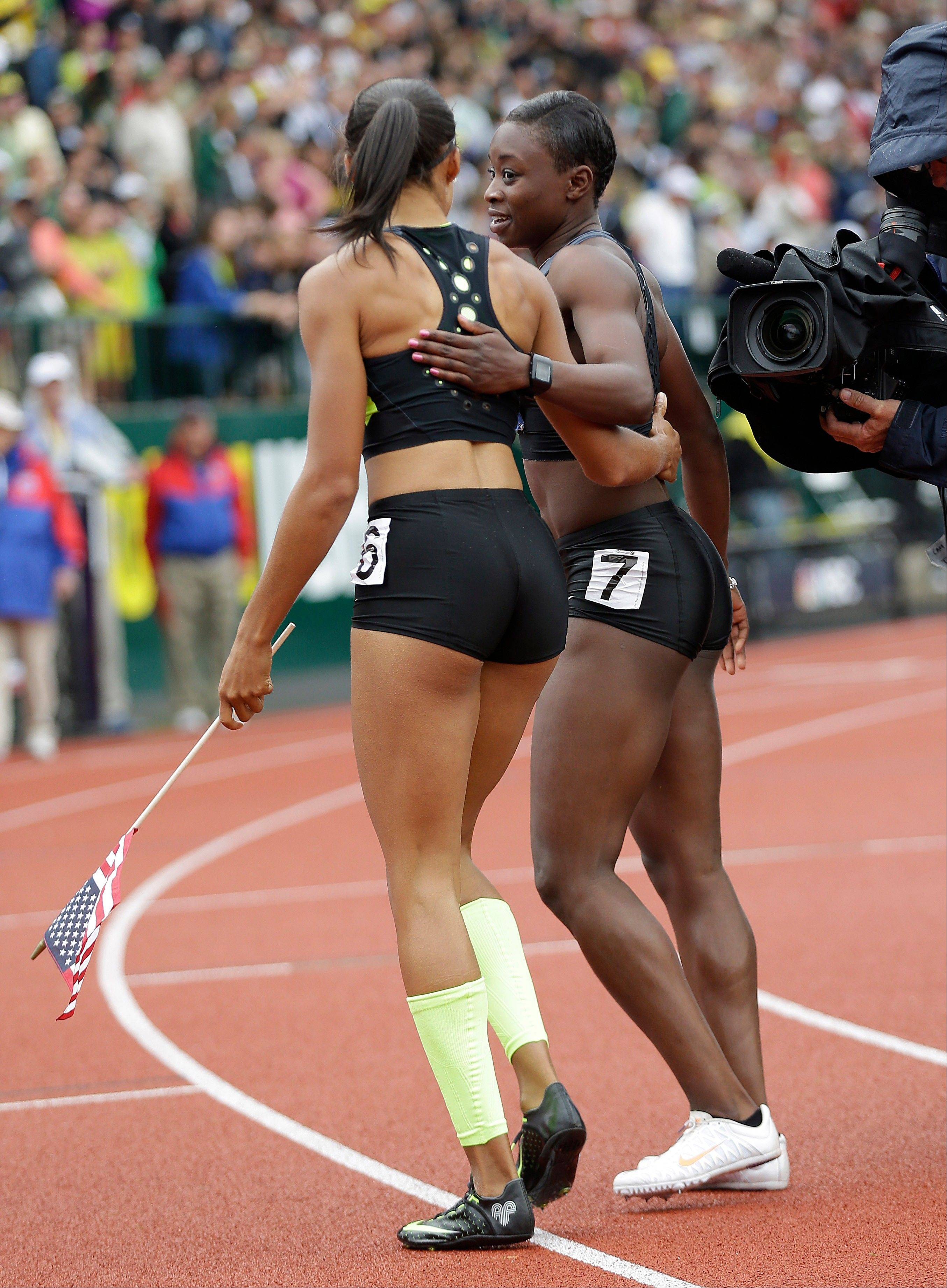 Allyson Felix, left, and Jeneba Tarmoh speak after the finish of the women's 200 meters at the U.S. Olympic Track and Field Trials Saturday, June 30 in Eugene, Ore. Felix won the 200 but she and Tarmoh tied for third place in the 100 meters. And Tarmoh backed out of the runoff scheduled for Monday.