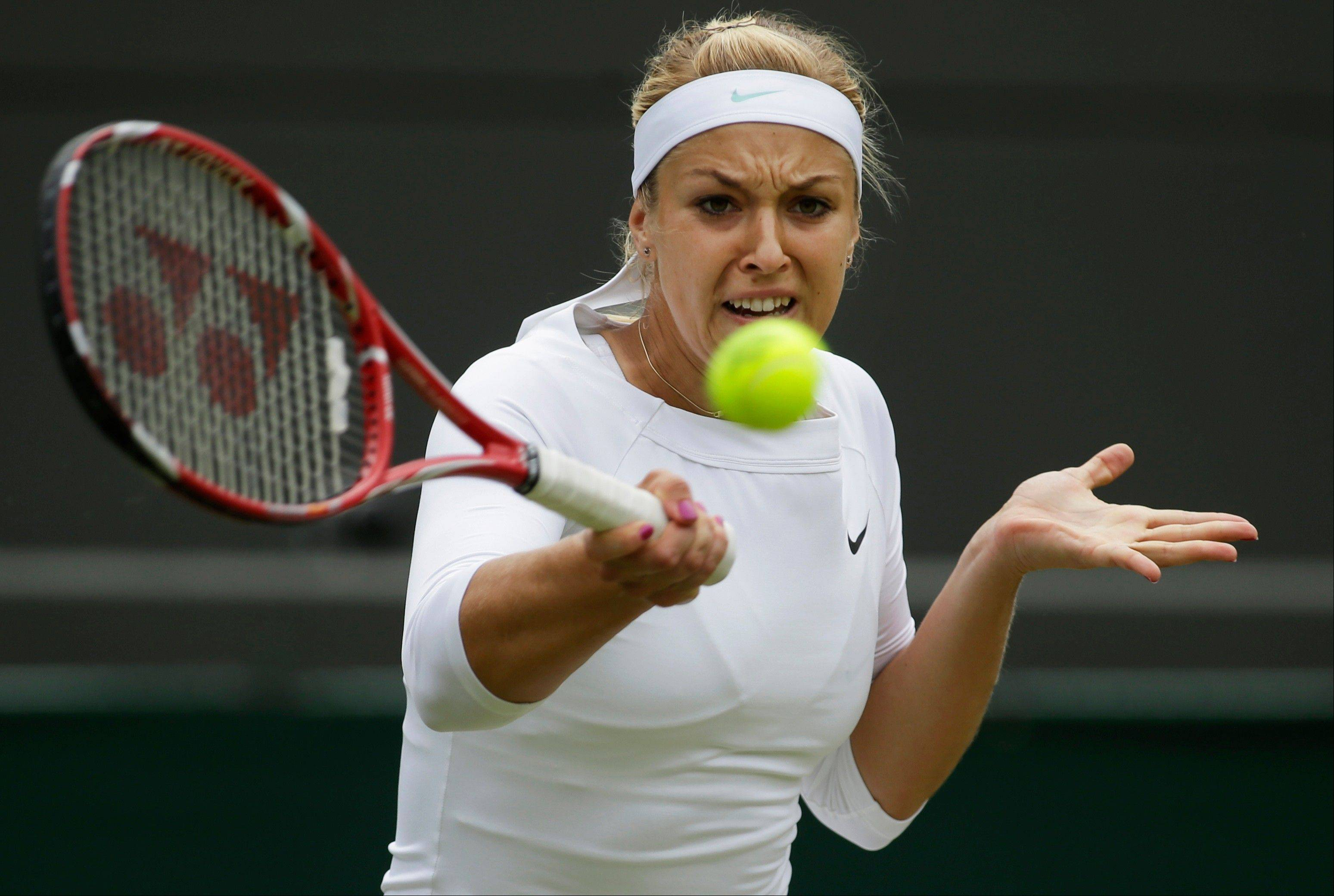 Maria Sharapova of Russia plays a return to Sabine Lisicki of Germany during a fourth round women's singles match Monday at the All England Lawn Tennis Championships at Wimbledon, England. Sharapova lost the match.