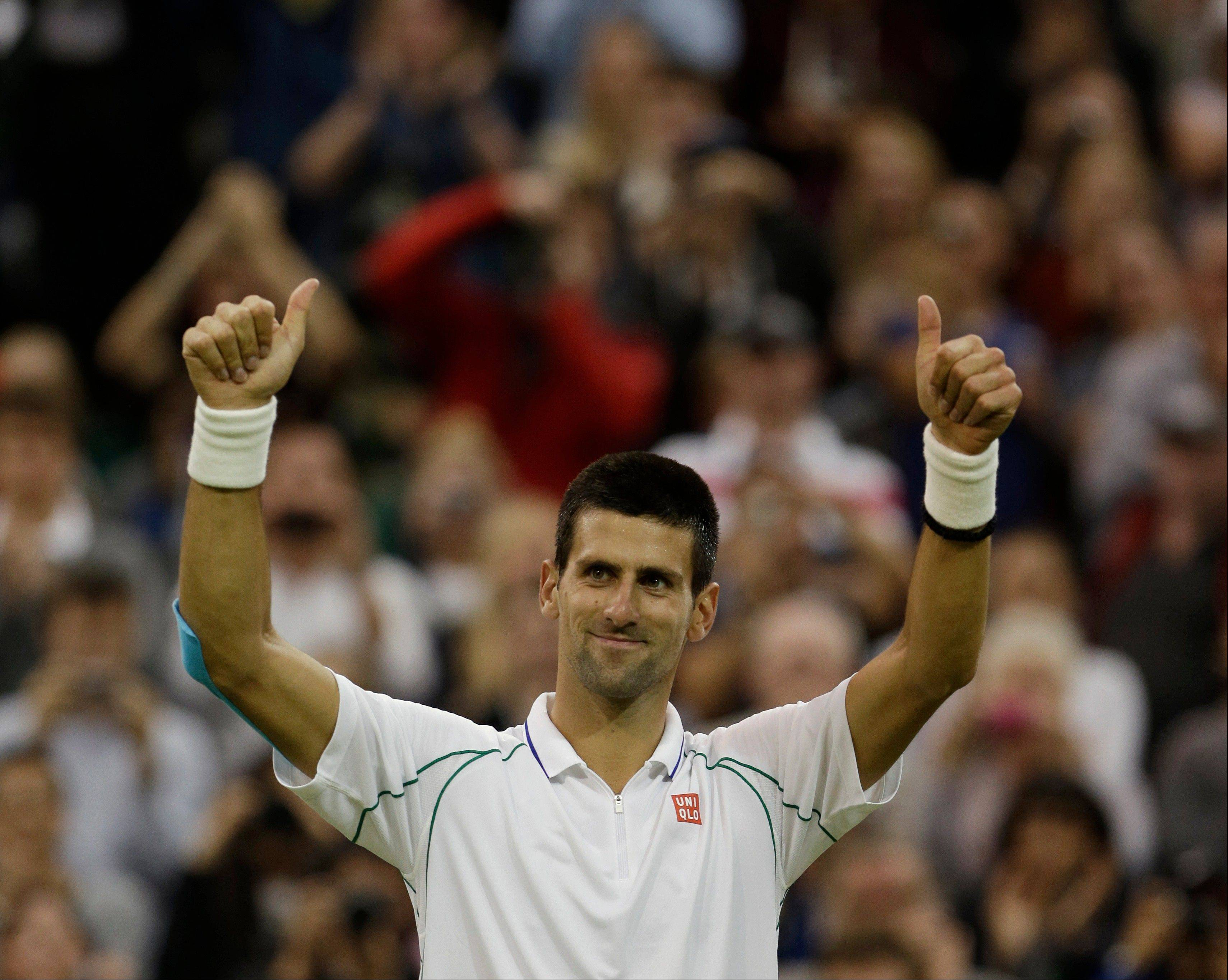 Novak Djokovic of Serbia reacts after defeating Viktor Troicki of Serbia during a fourth round singles match Monday at the All England Lawn Tennis Championships at Wimbledon, England.