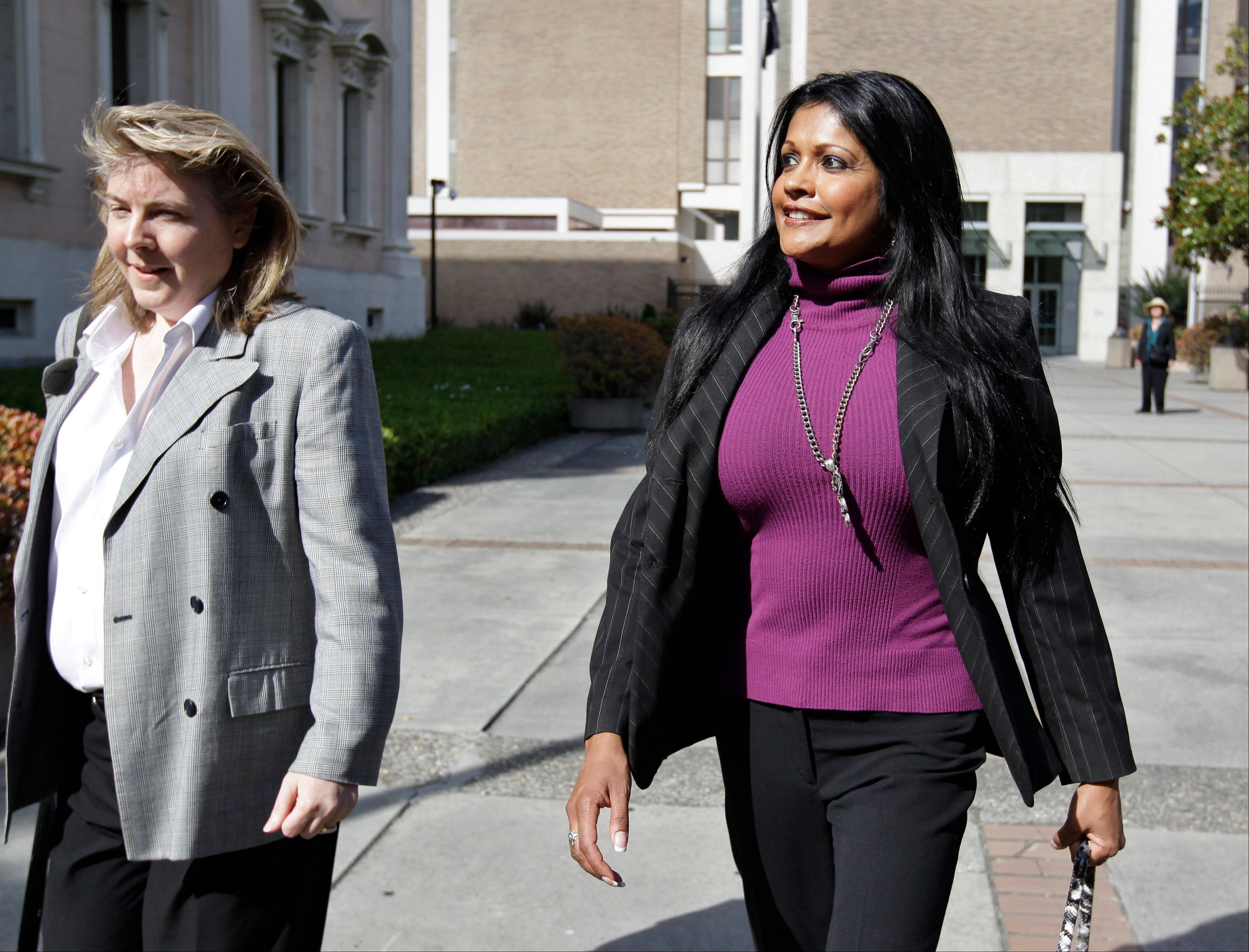 Amy Pinto-Walsh, right, girlfriend of artist Thomas Kinkade, leaves with her attorney, Sonia Agee, left, from a San Jose, Calif., courthouse in San Jose, Calif., Monday.