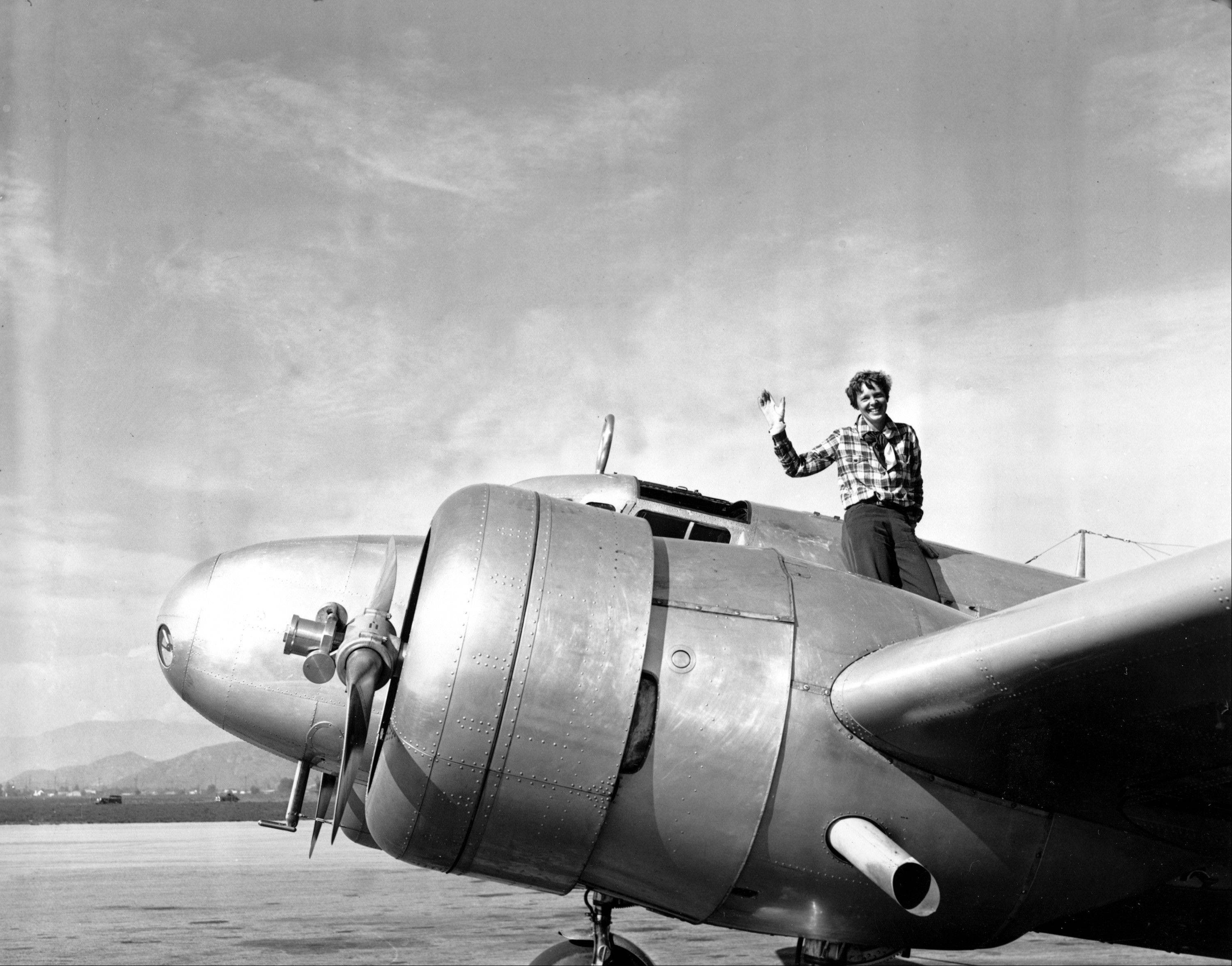 In a March 10, 1937 file photo American aviatrix Amelia Earhart waves from the Electra before taking off from Los Angeles, Ca., on March 10, 1937.