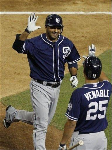 San Diego�s Jesus Guzman gets a high-five from teammate Will Venable after Guzman hit a pinch-hit home run Tuesday against the Arizona Diamondbacks during the eighth inning in Phoenix.