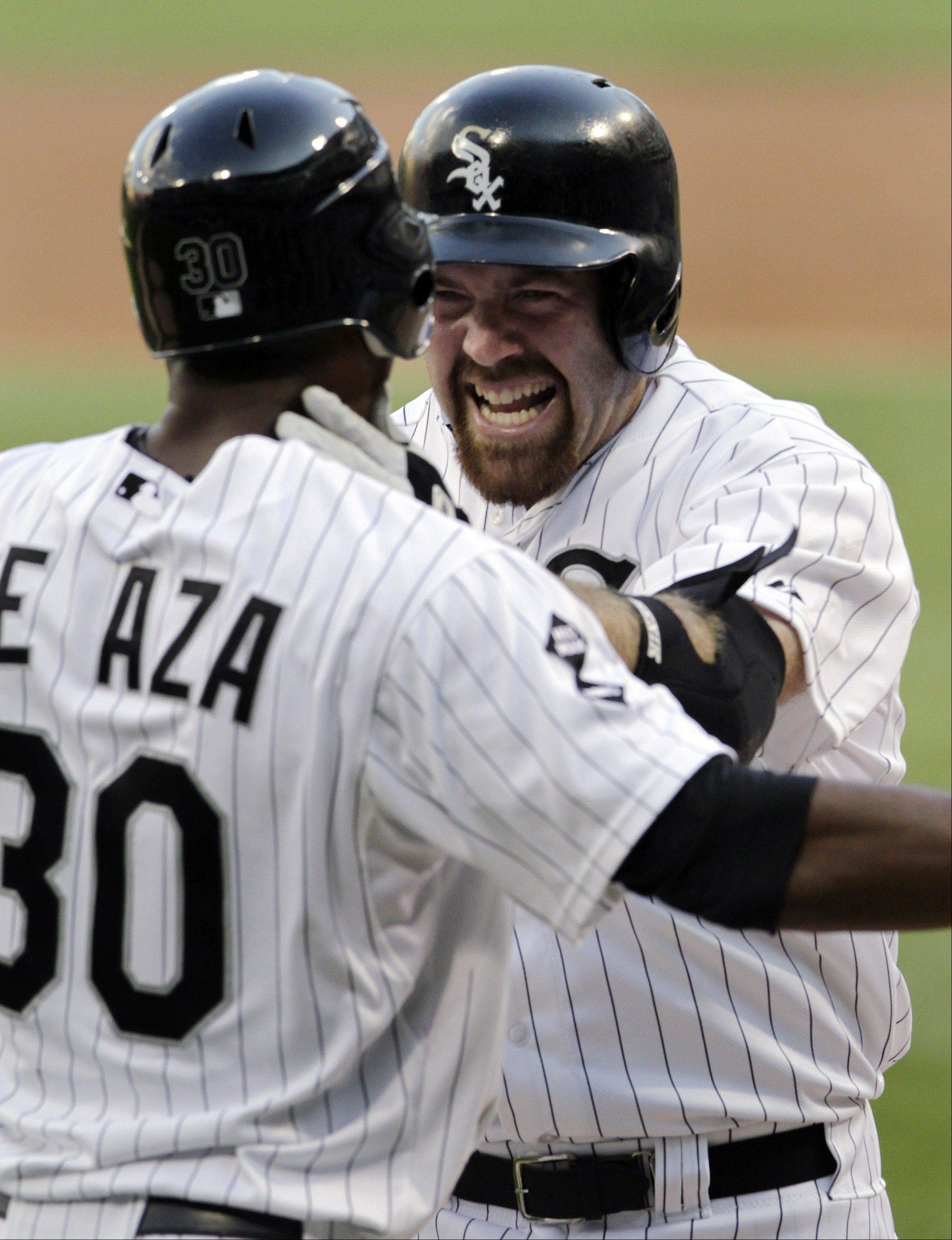White Sox third baseman Kevin Youkilis, right, celebrates with Alejandro De Aza as they scored on Youkilis' two-run home run Tuesday against the Texas Rangers during the first inning at U.S. Cellular Field.