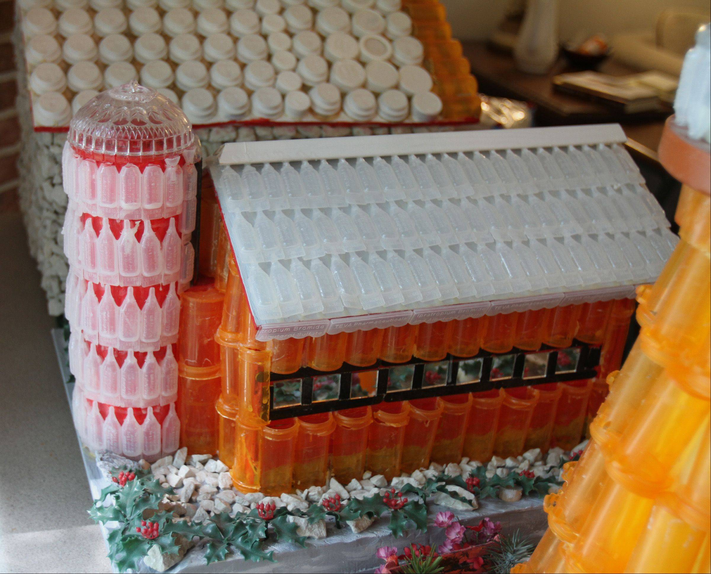 Modeled after the barn and silo on the farm where he grew up, 93-year-old World War II veteran Jake Joseph of Prospect Heights built this piece of folk art with dozens of empty medication containers compiled by his wife, Beatrice.