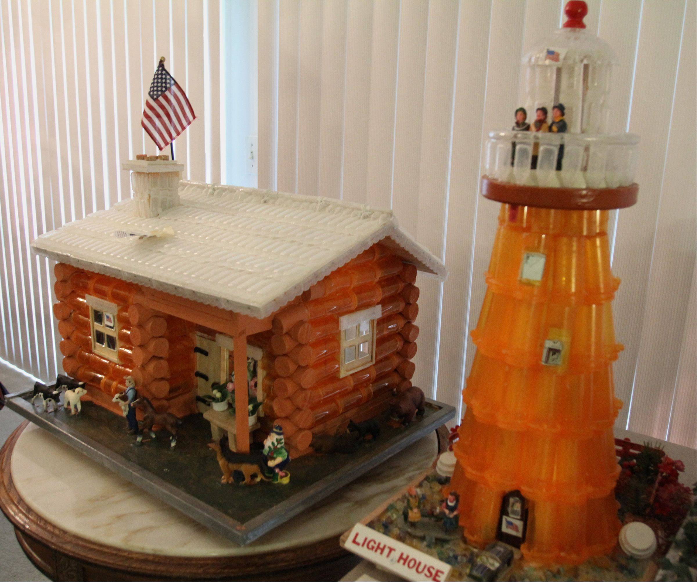Instead of focusing on their health problems, 93-year-old Jake Joseph uses the hundreds of empty pill bottles compiled by his wife, Beatrice, to build this log cabin, lighthouse and other one-of-a-kind creations in the couple's condo in Prospect Heights.