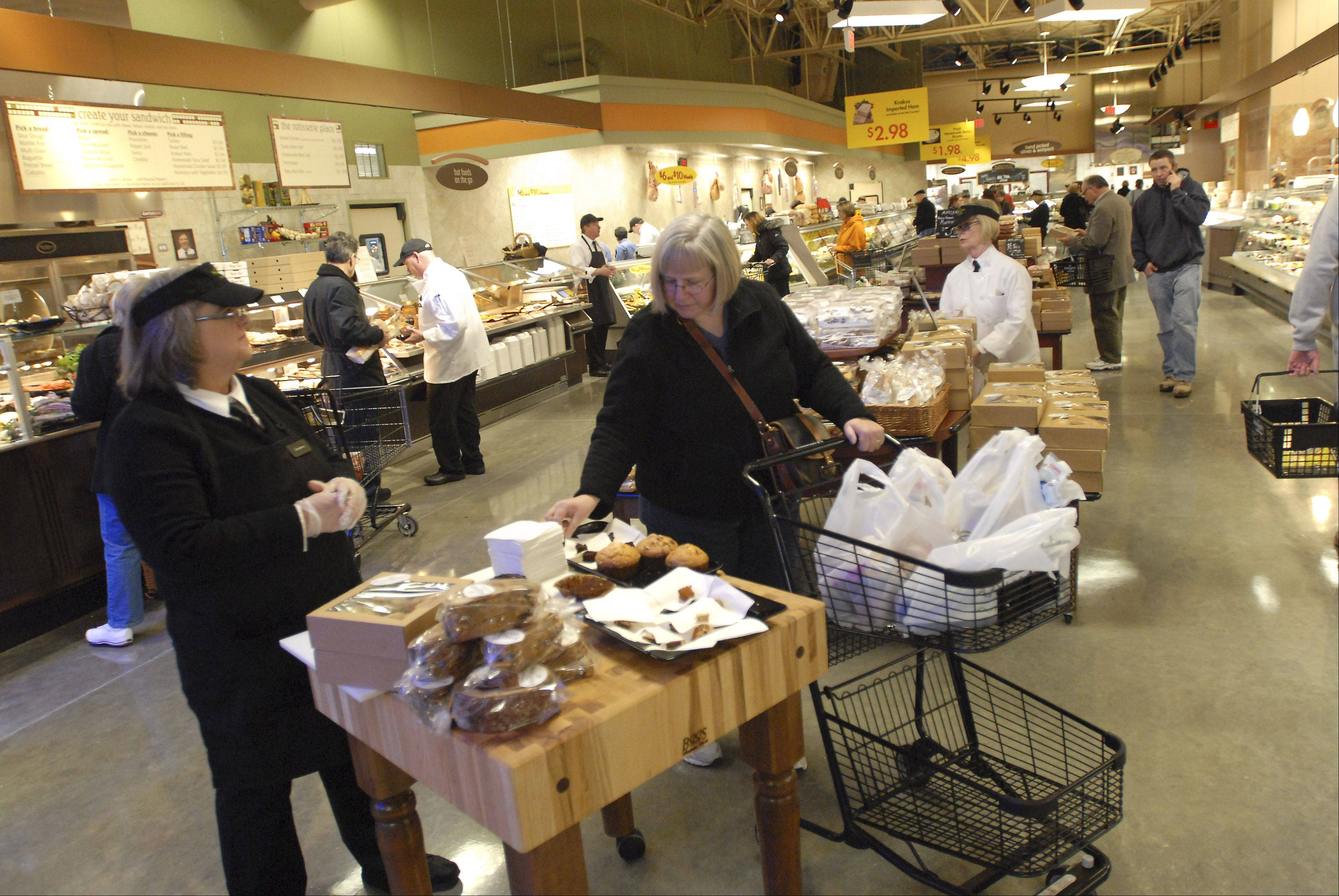 Customers try samples during the grand opening of Mariano's Fresh Market Tuesday in Palatine.