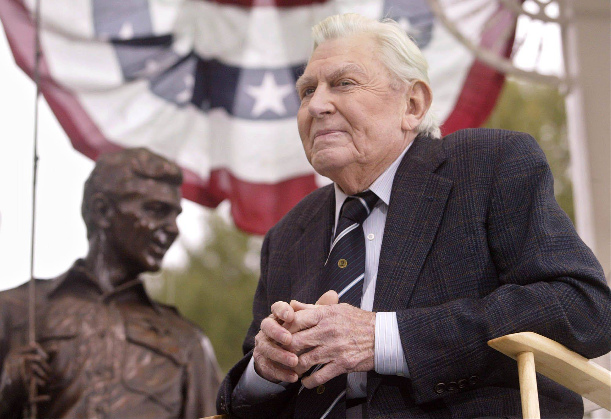 "Andy Griffith sits in front of a bronze statue of Andy and Opie from the ""Andy Griffith Show,"" in this Tuesday, Oct. 28, 2003 file photo, after the statue was unveiled during a ceremony in Raleigh, N.C. Griffith, the actor who portrayed the sheriff of the fictional town of Mayberry, N.C. died Tuesday in his North Carolina home."