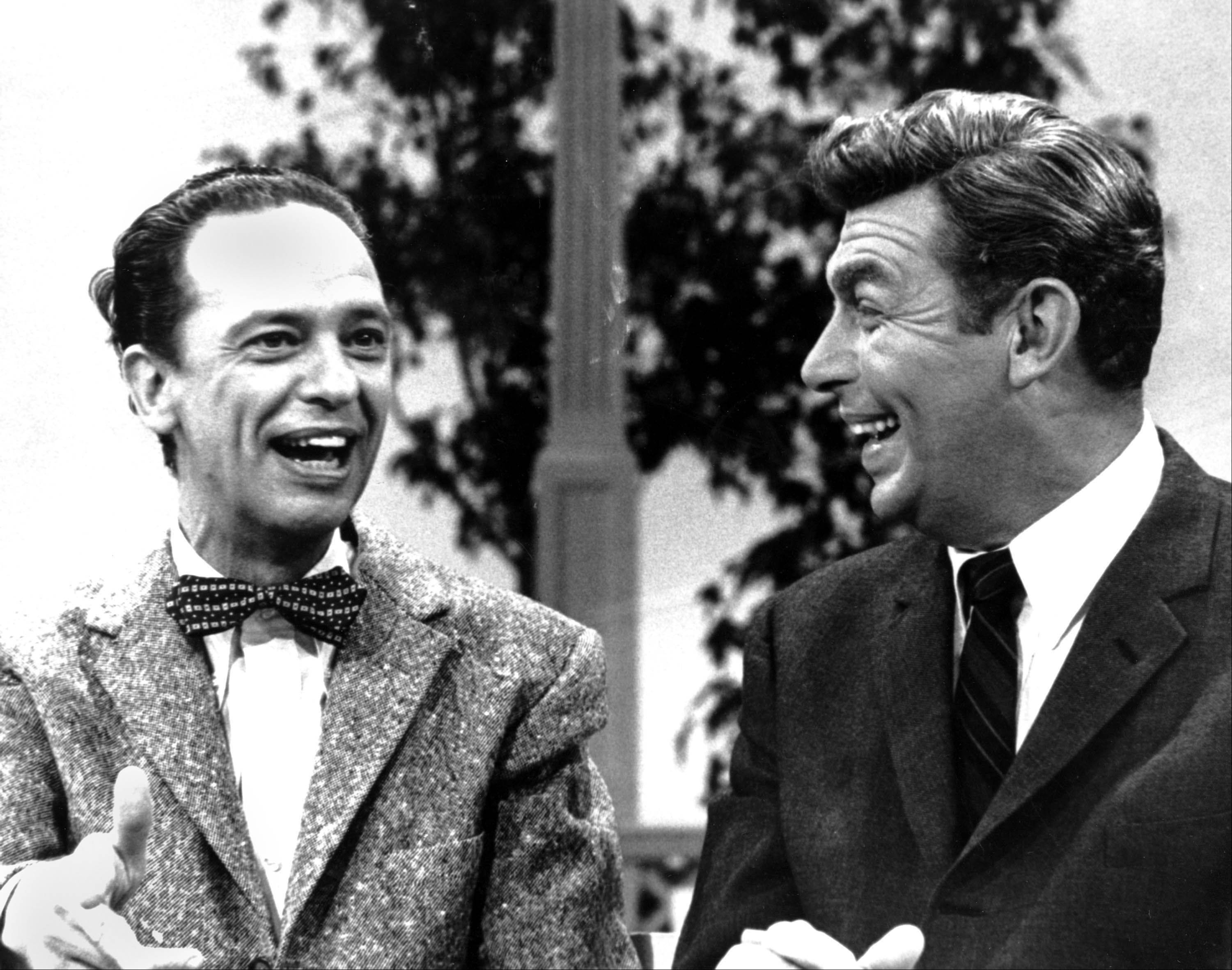 Andy Griffith laughs it up with Don Knotts while taping a television program on Oct. 20, 1967.