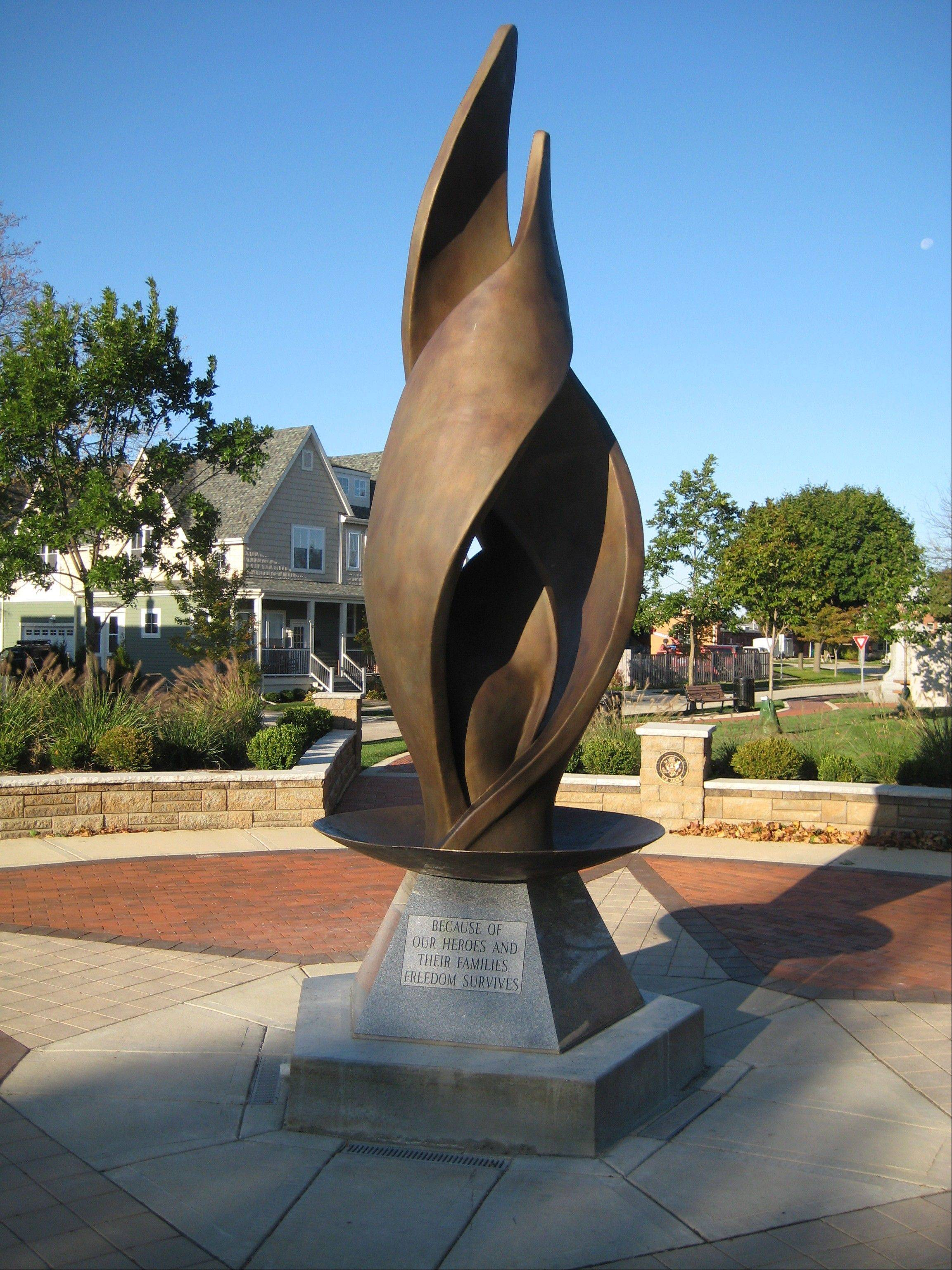 Fran Volz' 15-foot tall bronze eternal flame sculpture at Memorial Park.