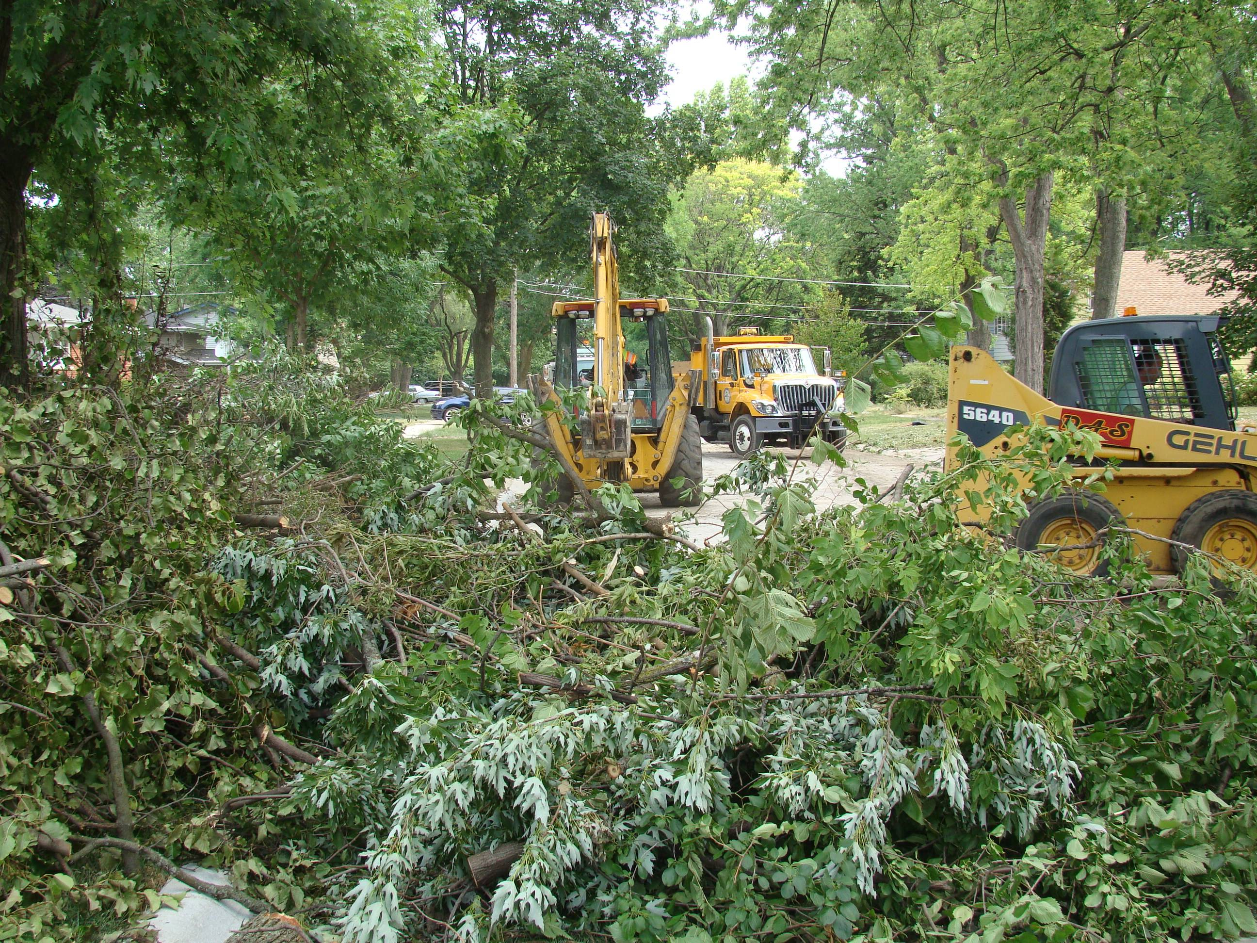 Public Works crews from Rolling Meadows assist Lombard Public Works crews today to clear branches and other debris left by the storm on Fairfield Avenue near Madison Meadows Park in Lombard.