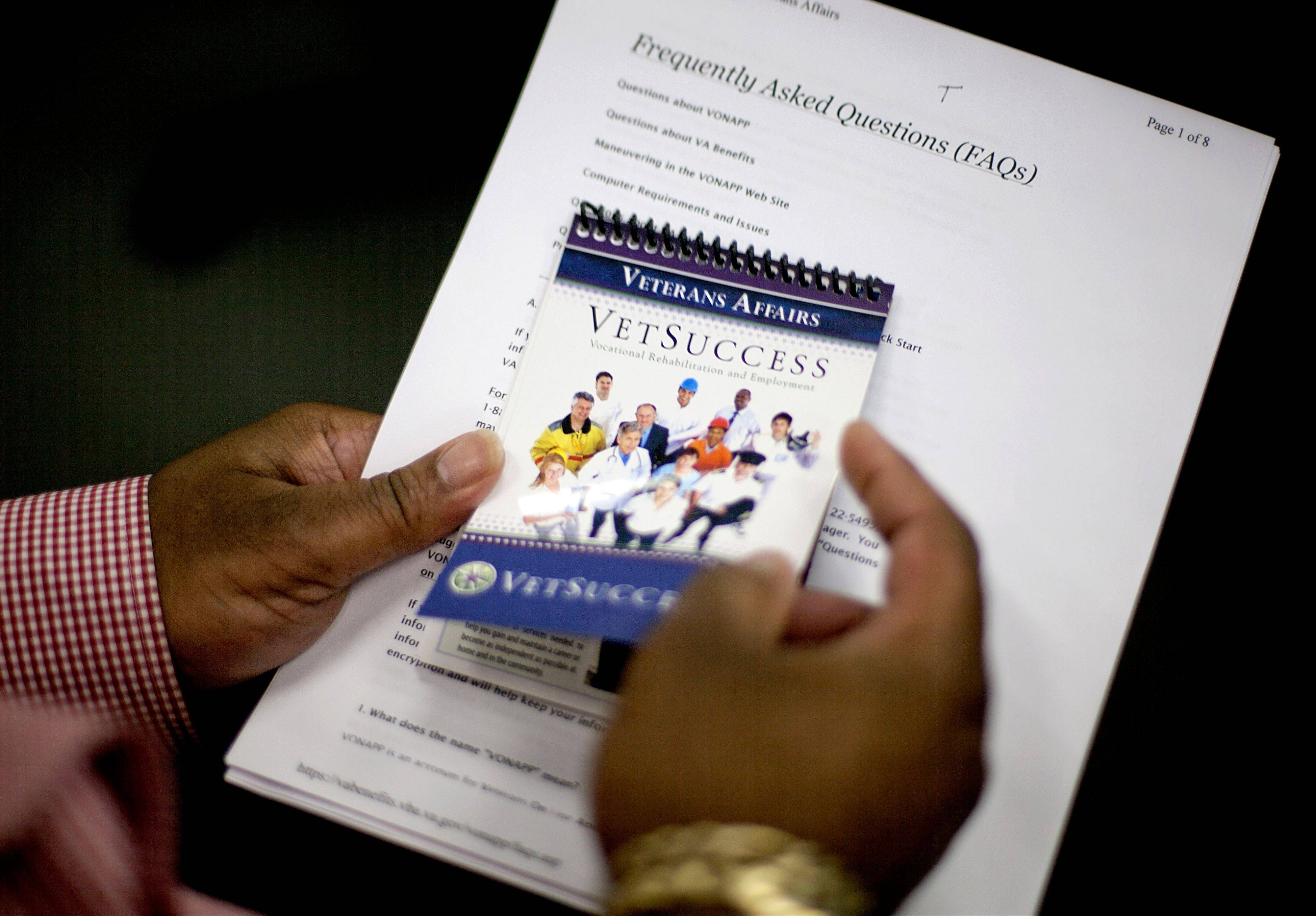 Army veteran Chester Dixon holds an information brochure as he sits in the Georgia Department of Labor office after applying for a a new skills-based program to get out-of-work veterans trained and back in the job market in Atlanta.