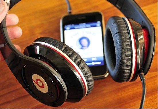 Upscale headphone maker Beats Electronics is buying MOG, a music subscription service that has struggled to compete with rivals such as Rhapsody and Spotify. Beats is the parent company of the �Beats by Dr. Dre� line of headphones.