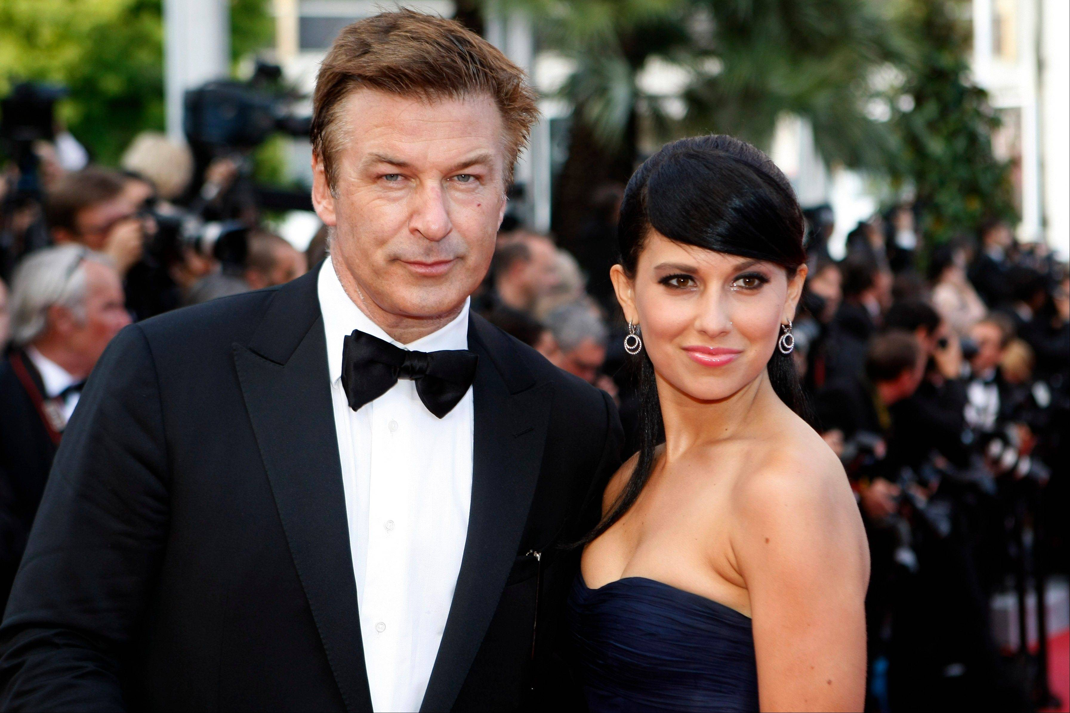 This May 26, 2012 file photo shows actor Alec Baldwin, left, and Hilaria Thomas arriving for the screening of Mud at the 65th international film festival, in Cannes, southern France.