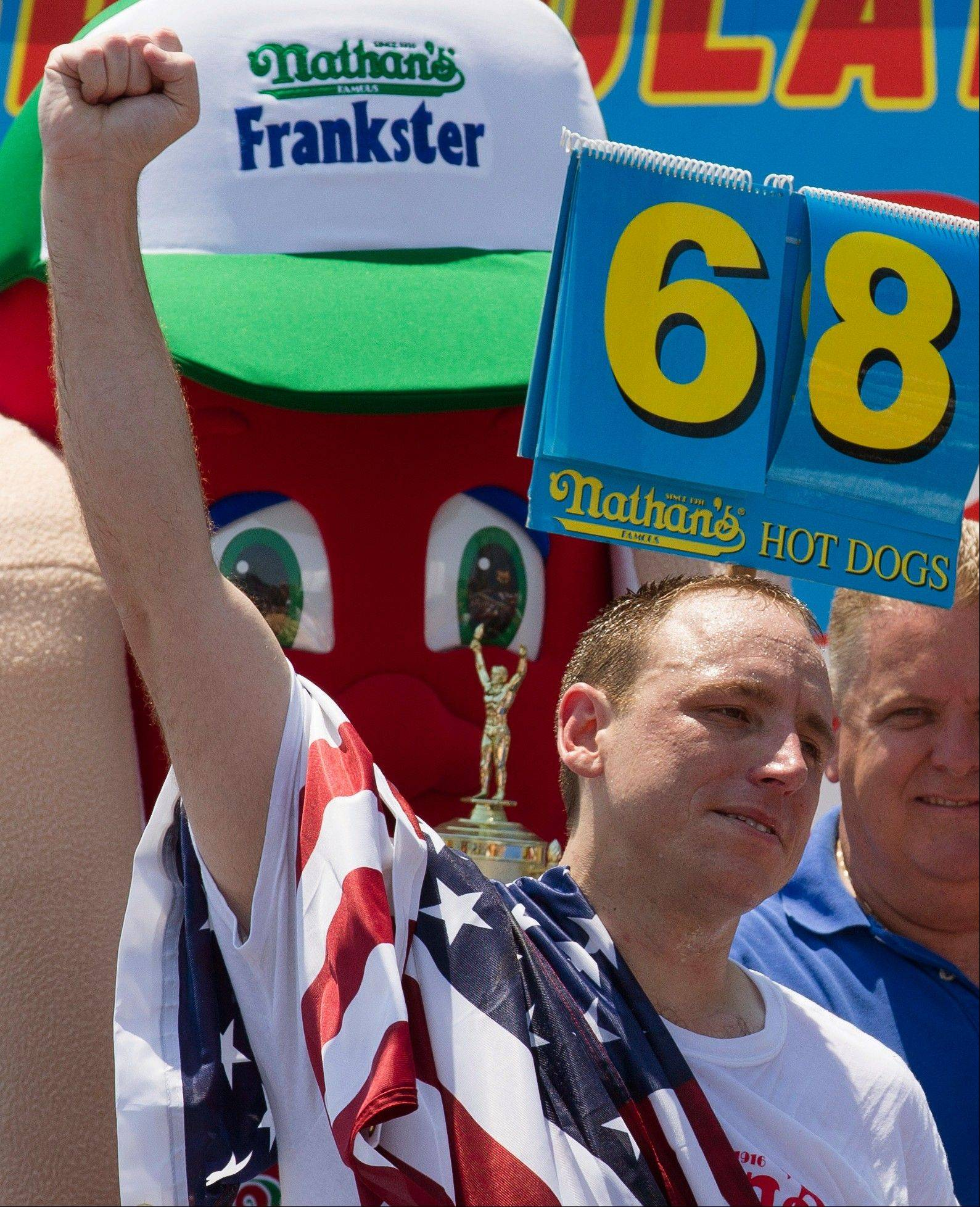 ASSOCIATED PRESS Five-time reigning champion Joey Chestnut celebrates after he wins his sixth Nathan's Famous Hot Dog Eating World Championship with a total of 68 hot dogs and buns Wednesday at Coney Island.