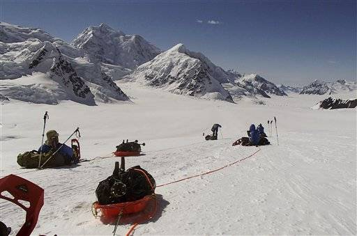 In this June 13, 2012, file photo provided by Disabled Sports USA, members of Warfighter Sports Denali Challenge pull gear while attempting to climb Mount McKinley in Alaska. The five men, all severely wounded in war, including four who had amputations, had to abandon their climb of North America's tallest peak, but say it was weather and not their disabilities that ended the summit attempt. The five men descended Alaska's Mount McKinley on Monday, July 2.